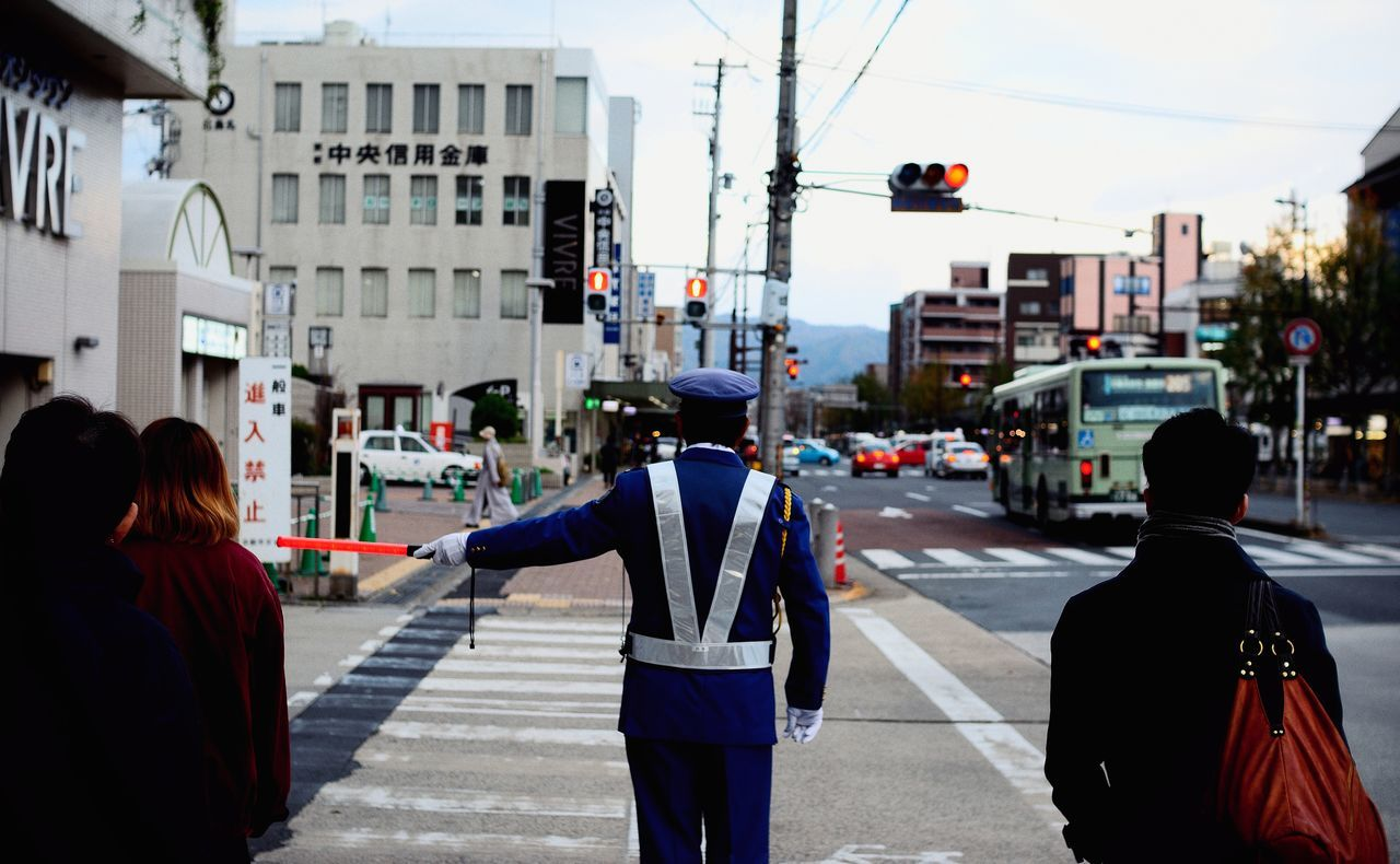 Whatch Whatchman Guard Sequrity Police Traffic Control Traffic Kyoto Street Photography Cool Capture The Moment 2016 EyeEm Awards My Year My View The Street Photographer - 2016 EyeEm Awards The Great Outdoors - 2016 EyeEm Awards Roadside Crossroads People Bus Car