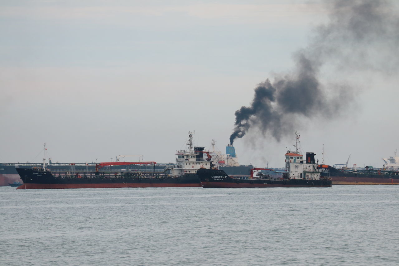 When the smoke is going up Cargo Container Commercial Dock Day Freight Transportation Harbor Industry Mode Of Transport Nature Nautical Vessel No People Outdoors Sea Ship Shipping  Shipyard Sky Transportation Water Waterfront