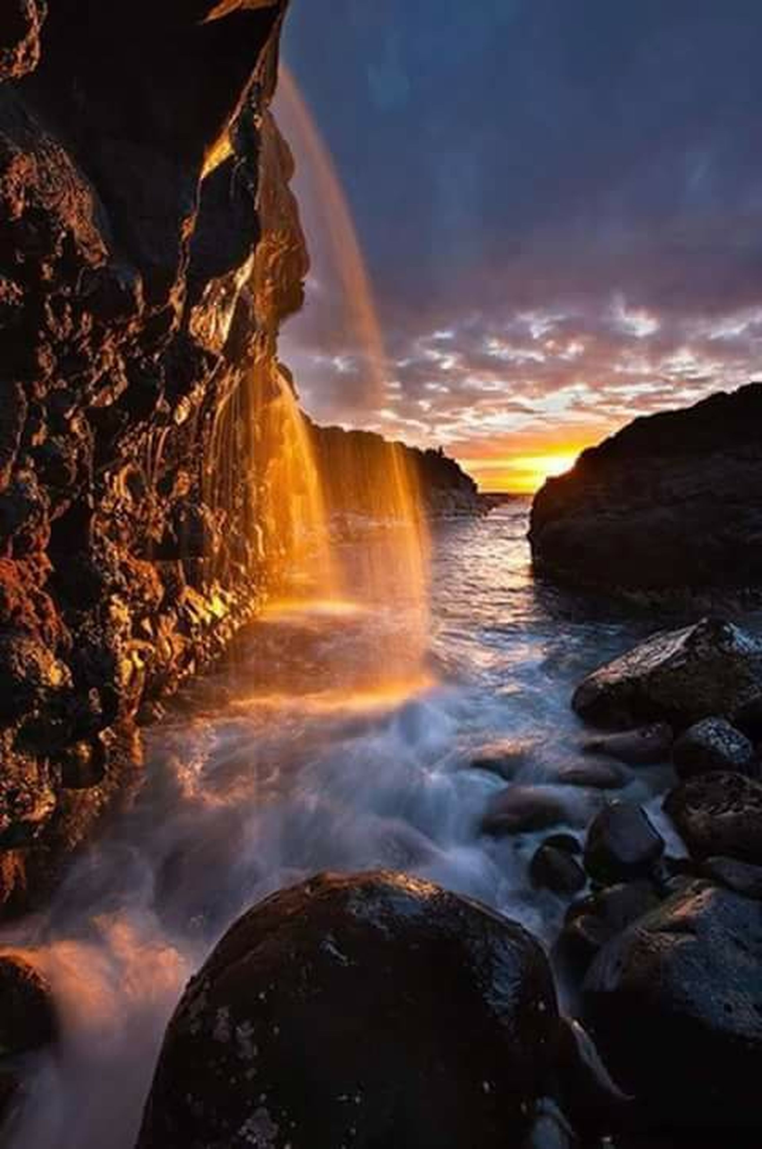 water, scenics, beauty in nature, tranquil scene, rock - object, sky, sunset, tranquility, nature, rock formation, idyllic, cloud - sky, rock, sea, non-urban scene, cloud, shore, outdoors, reflection, orange color