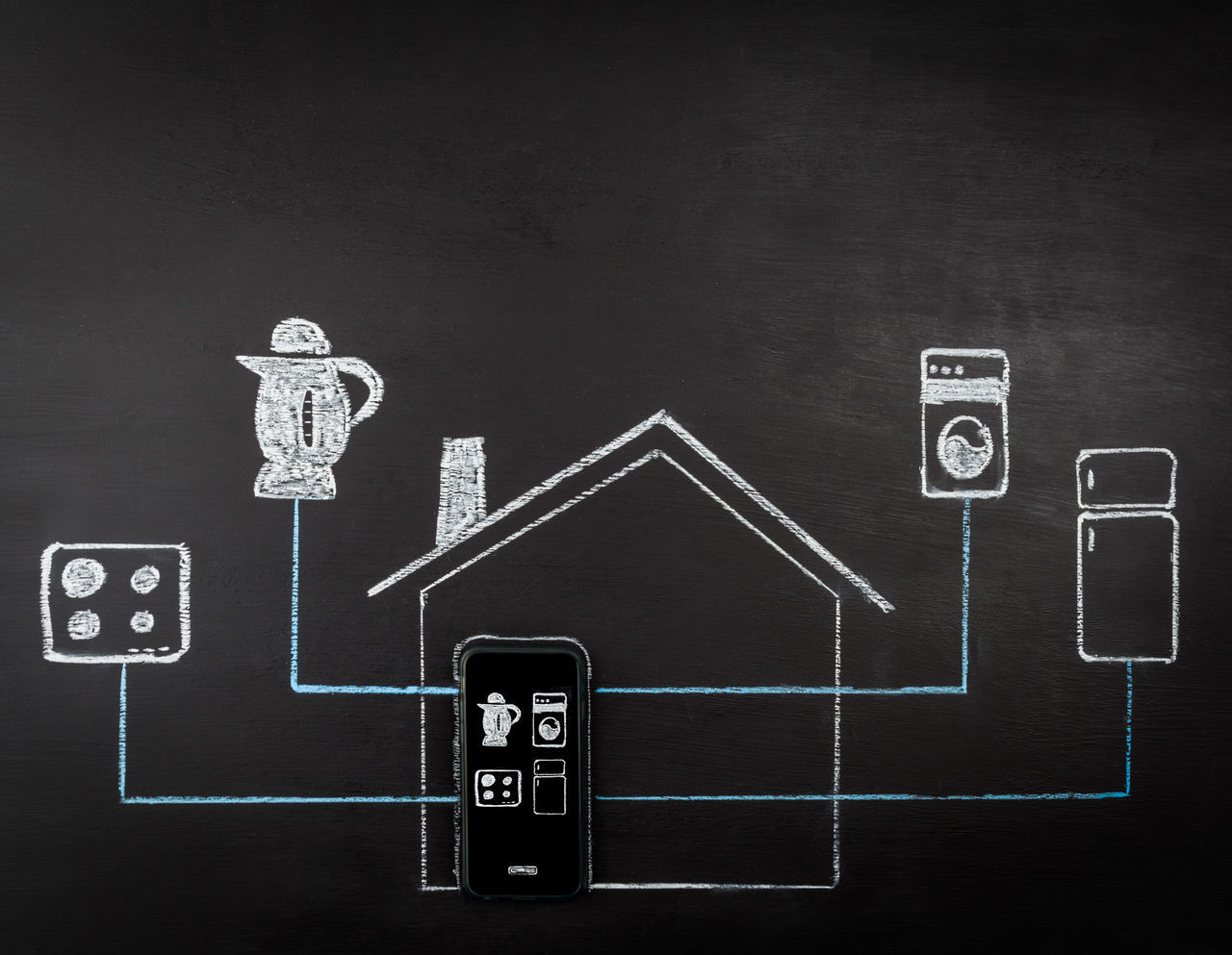 Smart house concept hand drawing on chalk board. Mobile phone controlling home appliances. Horizontal image with copy space. Appliances Blackboard  Communication Concept Human Representation No People Smart Home Smart On Technology Technology Everywhere