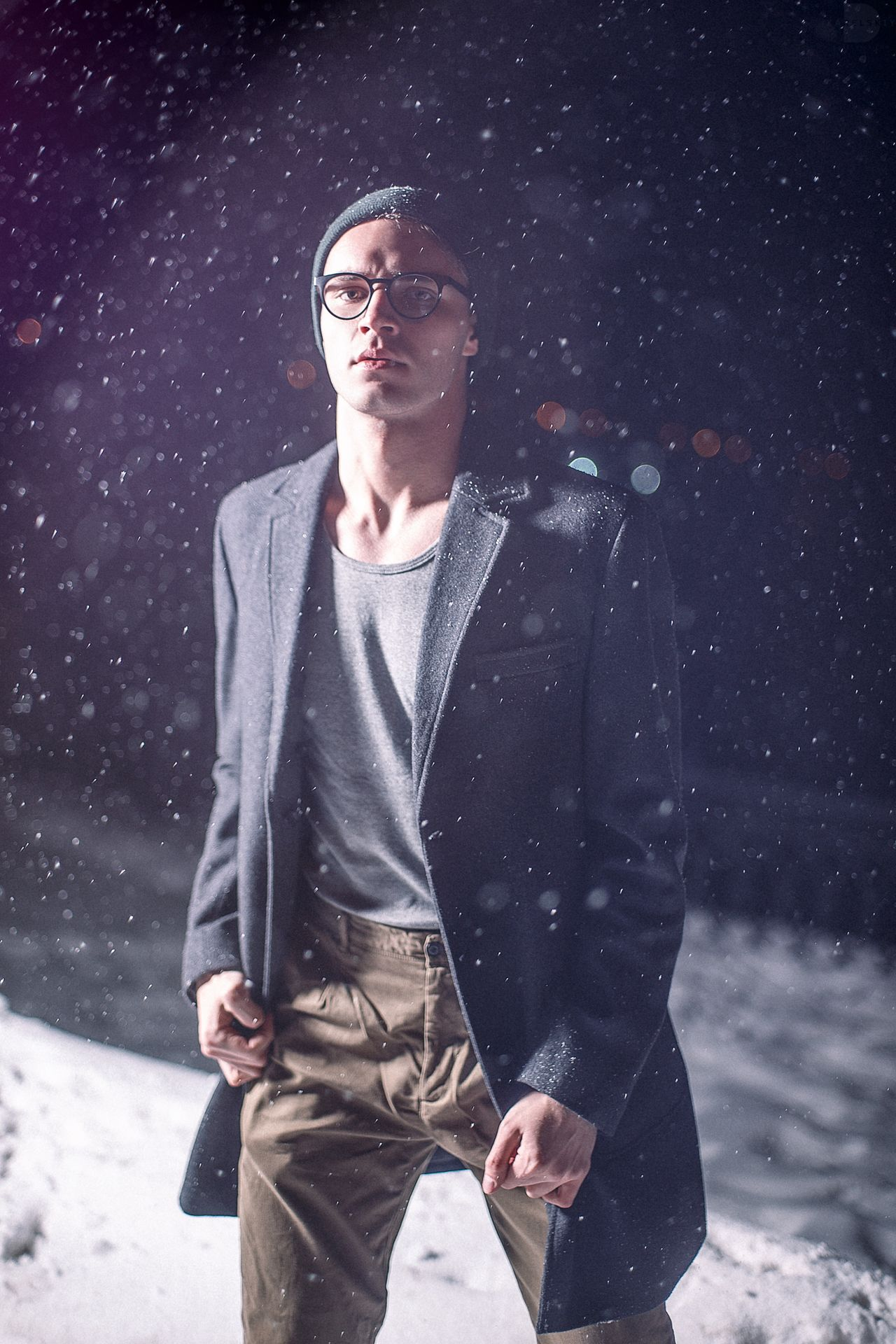 Young Adult Snow Winter Only Men Three Quarter Length Snowing Hands In Pockets One Man Only Cold Temperature Eyeglasses  One Person Standing Adults Only Men People Warm Clothing Adult Snowflake Outdoors Night