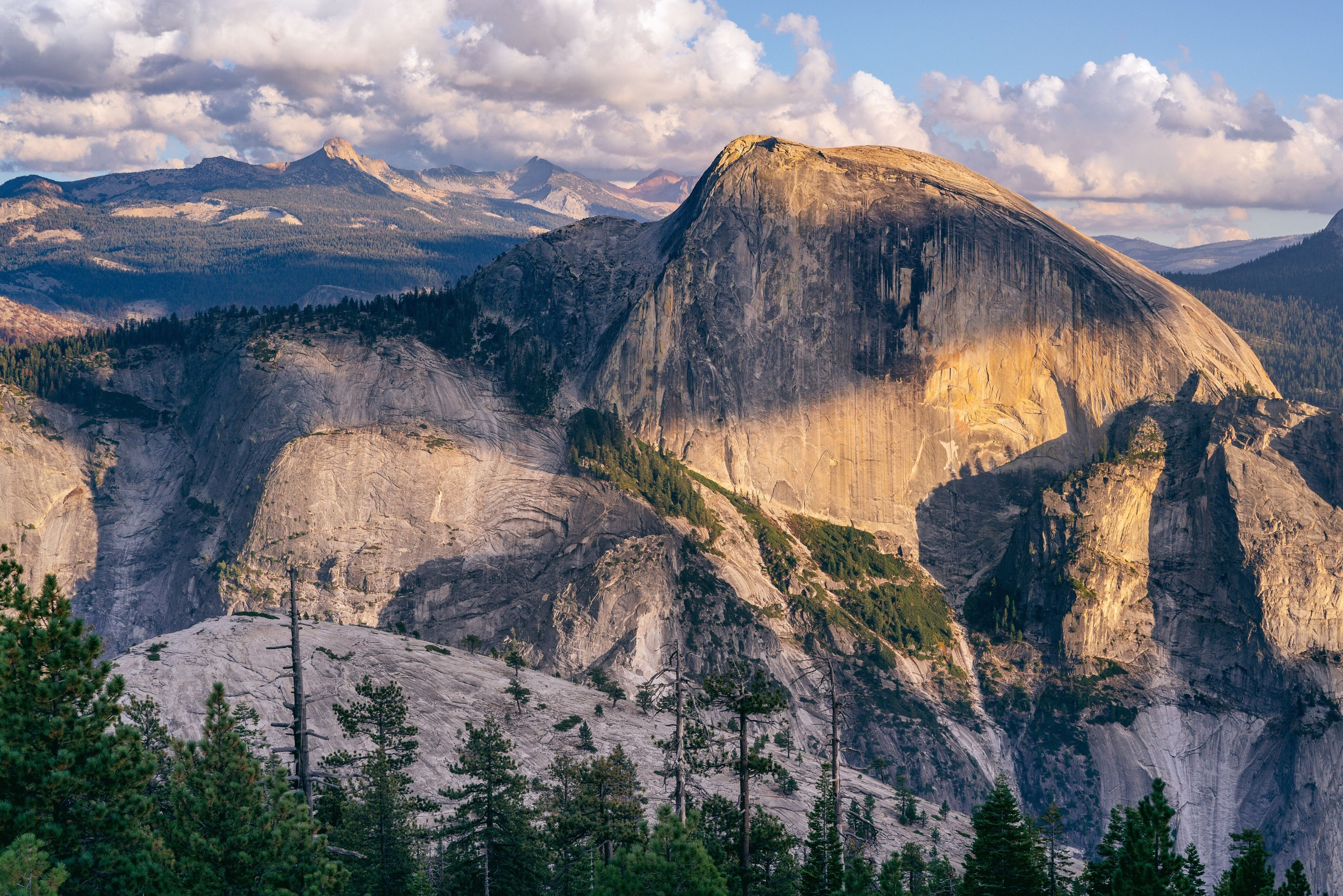 mountain, sky, tranquil scene, tranquility, scenics, landscape, rock formation, beauty in nature, nature, geology, physical geography, cloud - sky, rock - object, mountain range, non-urban scene, cloud, remote, idyllic, cliff, rocky mountains