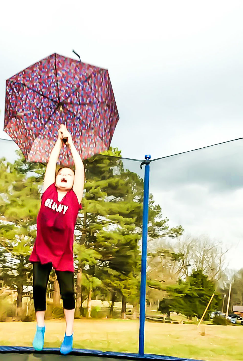 Child Activity Outdoors One Person Exercising Sport Athlete Young Adult Sports Event  Taking A Shot - Sport Action Showing Motion Motion Motion Shot Outdoor Activity Floating On Air Learning To Fly Trampoline Umbrella Funny Kid Funny Moment Childhood Facial Expression