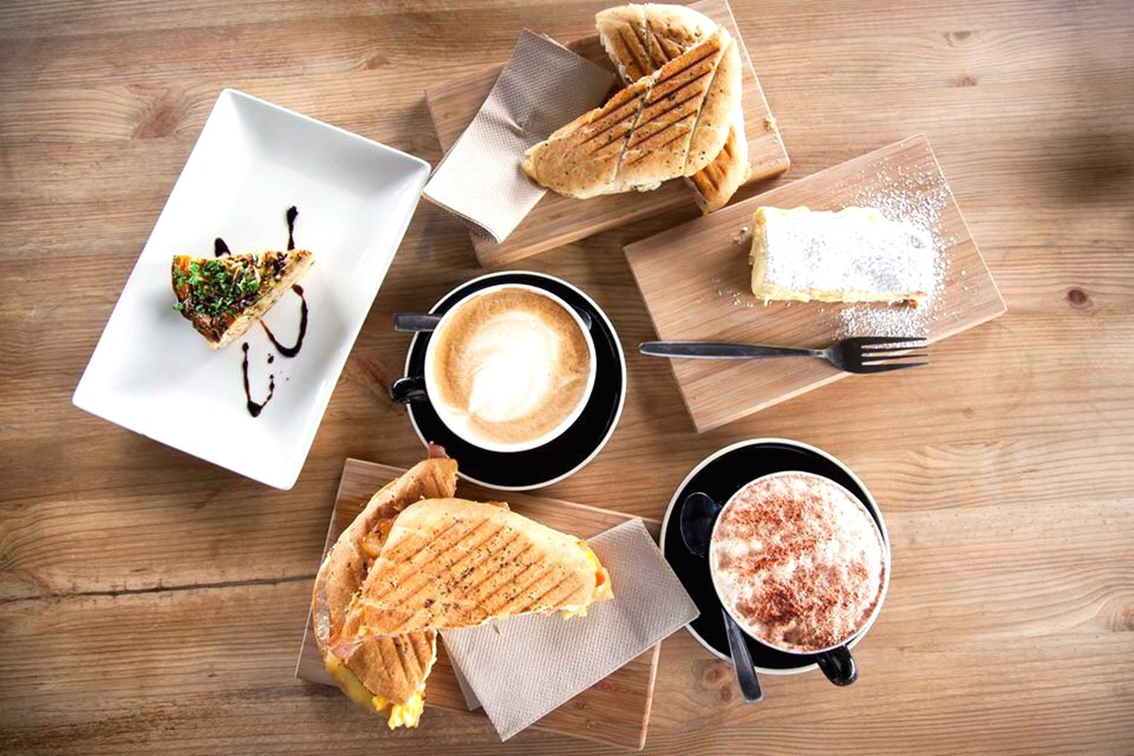 food and drink, table, food, freshness, indoors, plate, still life, ready-to-eat, drink, healthy eating, high angle view, directly above, wood - material, meal, breakfast, serving size, fork, refreshment, bread, spoon
