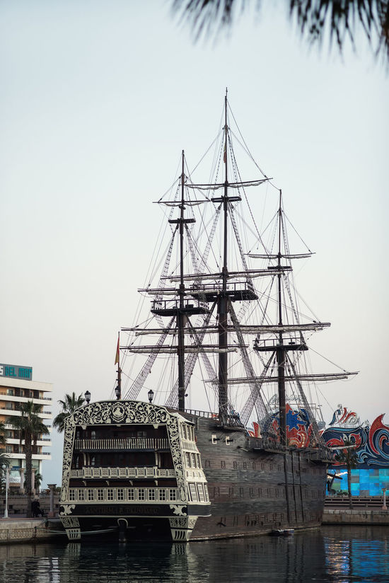 "Alicante, Spain- February 24, 2016: Ship ""Santisima Trinidad"" in the port of Alicante. Ship is an exact replica of the ""Santisima Trinidad"". It took over 2 years to build and cost more than 4 million Euros. Costa Blanca. Spain Alicante, Spain Costa Blanca Day Docked Ship Evening Famous Place Galleon Harbor History Landmark Mast Mediterranean Sea Moored Ship Nautical Vessel Old-fashioned Outdoors Port Promenade Replica  Retro Styled Santisima Trinidad Ship SPAIN Tourist Attraction  Travel Destinations"
