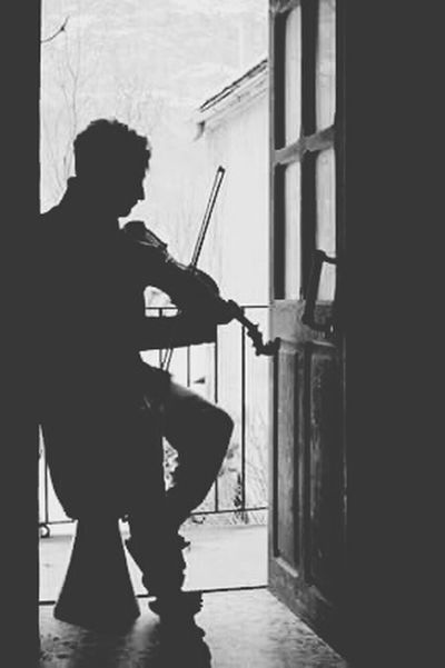 Music Is Life That's Me People Portrait Light And Shadow Lifestyles Street Photography People_bw Black And White Door Black & White Shadows & Lights Shadows Silouette People Photography Musical Instruments Violinist Violin Point Of View Music Photography  Musiclover Thinking About You