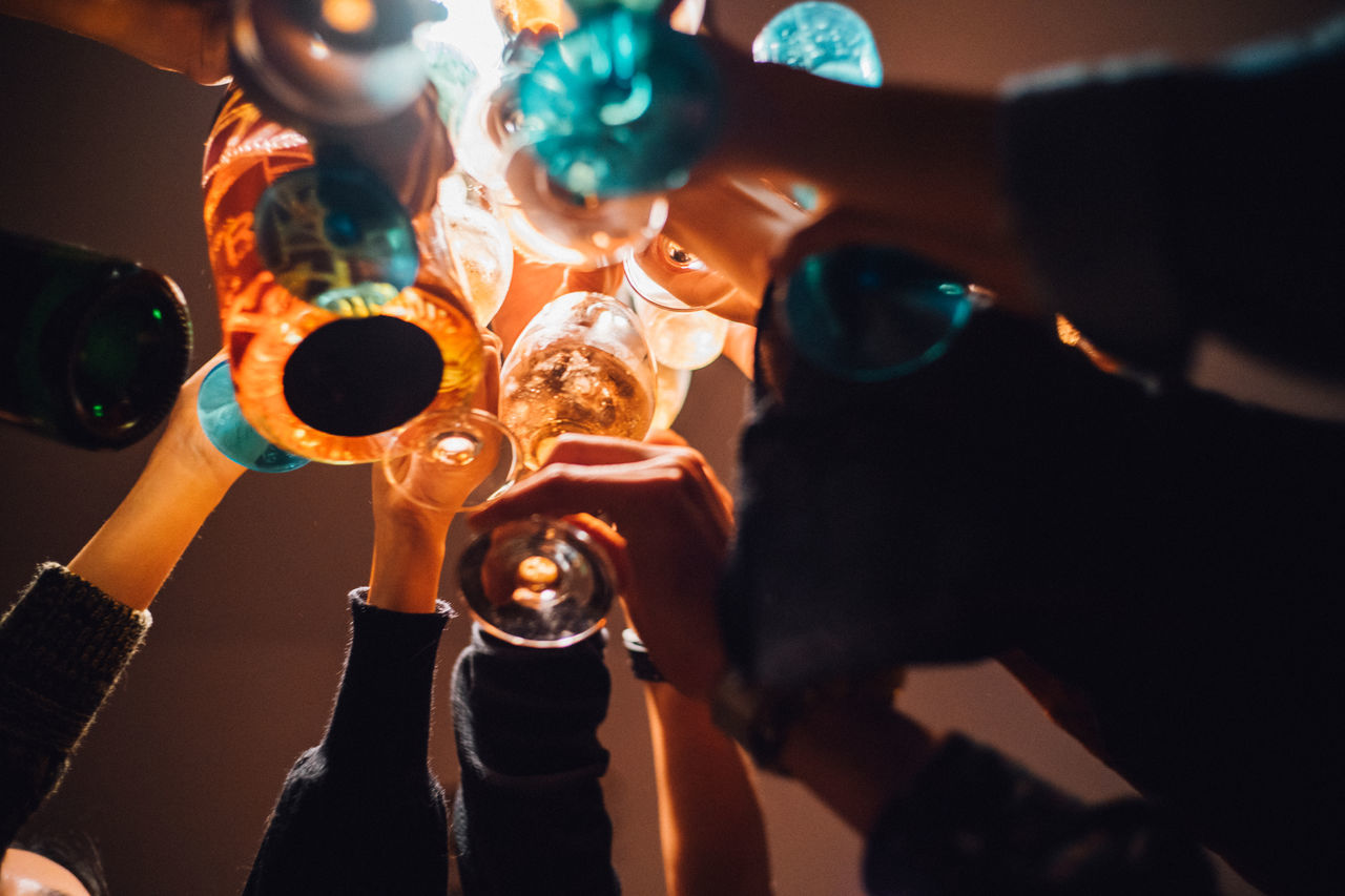 2017 New Year Adult Adults Only Camera - Photographic Equipment Celebrating Celebration Cheering Cheers Close-up Dinner Time Drinking Glass Drinks Gathering Indoors  Journalism New Year's Eve Party - Social Event Premiere Toast Togetherness Wine Moments