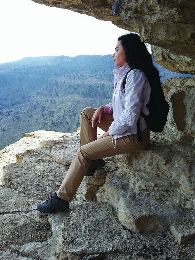 Sitting Full Length Casual Clothing Young Adult Lifestyles Leisure Activity Tourism Travel Destinations Nature Sky Physical Geography Ethereal Young Women Rock - Object Relaxation Looking Down Hands Clasped Mountain Cross-legged Day Mature Adult Nature Long Hair Non-urban Scene Tranquil Scene mountain