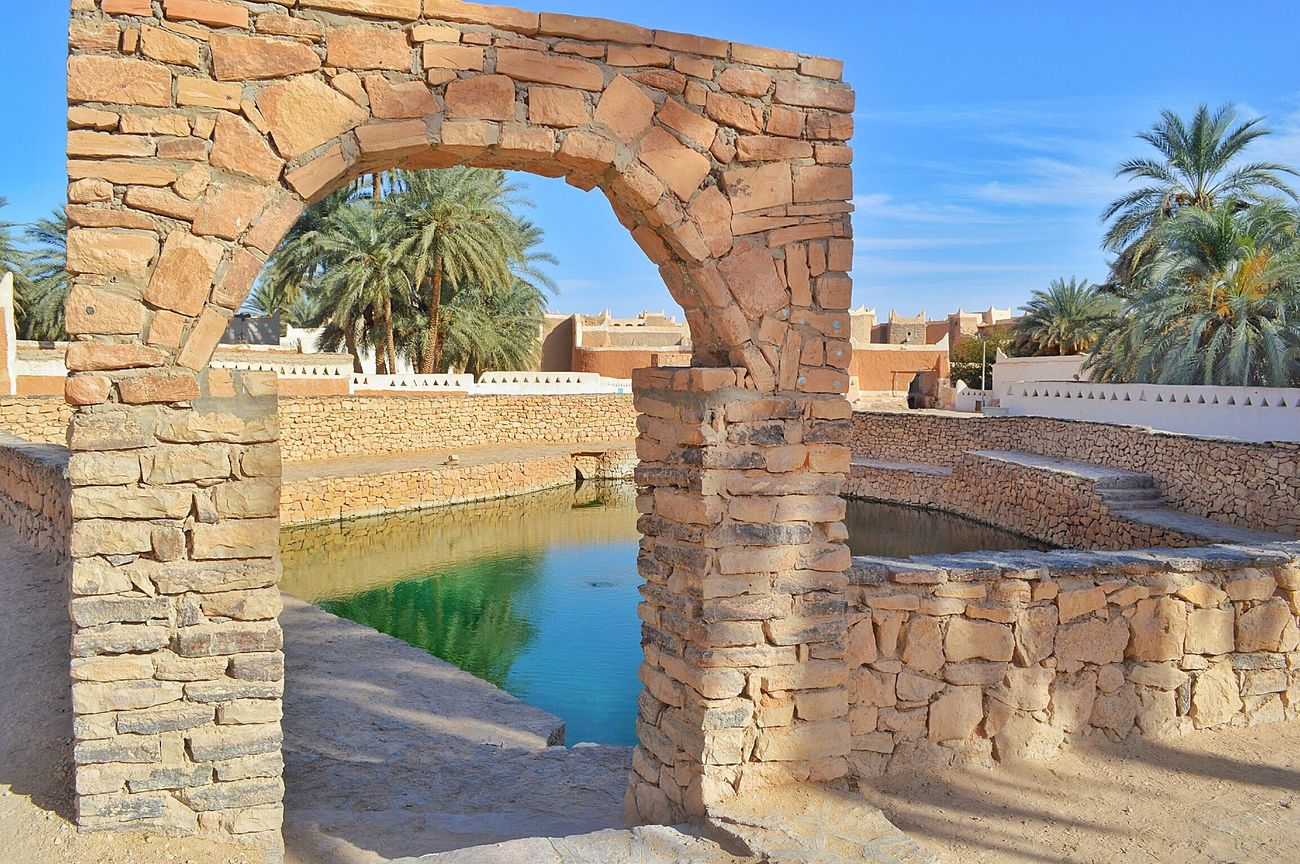 Libya Ghadames HeritageVillage Heritage Archaeological Tradition Palm Trees Snapseed Nikon D3200 Oldcity ليبيا غدامس Heritage Buildings Sunlight ☀ Pool Lakeview Lake Eye Horse Spring Water Spring Lake Stones Wall Shadows Reflections In The Water Enfras
