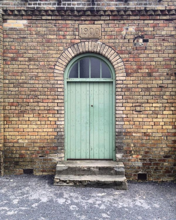 When one door closes, another one opens. Architecture Building Exterior Door Built Structure Closed Brick Wall No People Outdoors Entrance Entryway Closed Door Day Northumberland_uk Metal Industry Coal Mining History Wanderlust England Northumberland National Park History Through The Lens  History Landscape_Collection Northumberland Landscape Architecture Architecture_collection