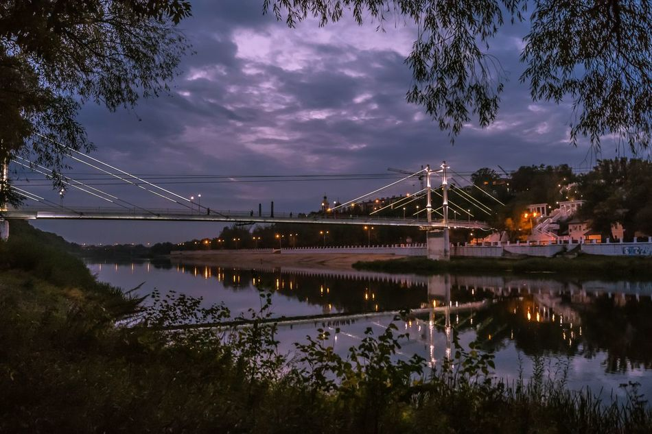 Reflection Night Illuminated Sky Water River Scenics Tree Bridge - Man Made Structure Outdoors Nature No People Beauty In Nature Astronomy Star - Space Blue Sky Travel Destinations Built Structure Landscape Beauty In Nature Bridge River Ural Shadow Environment Vibrant Color