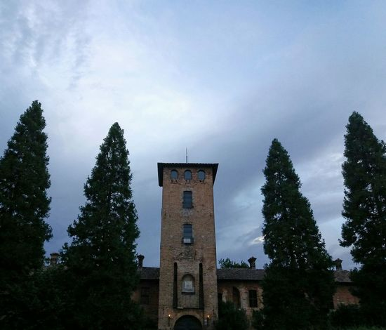 Castle in the trees Tree Business Finance And Industry Cloud - Sky Architecture No People Travel Destinations Outdoors Sky Day Building Exterior Politics And Government Clock Pines Sommergefühle EyeEmNewHere Rural Scene Peschiera Borromeo