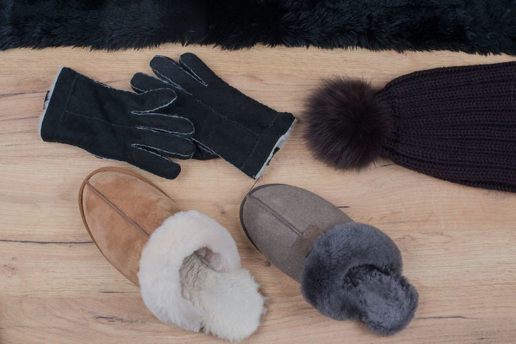 Winter accessories photographed on wood background Fashion Façade Isolated Slippers Wall Winter Wood Accessories Background Composing Cut Out Flat Lay Fur Fur Scarf Gloves Leather Gloves Material Pattern Red Fox Surface Texture Warm Wooden Board Wooden Wall Wool Hat
