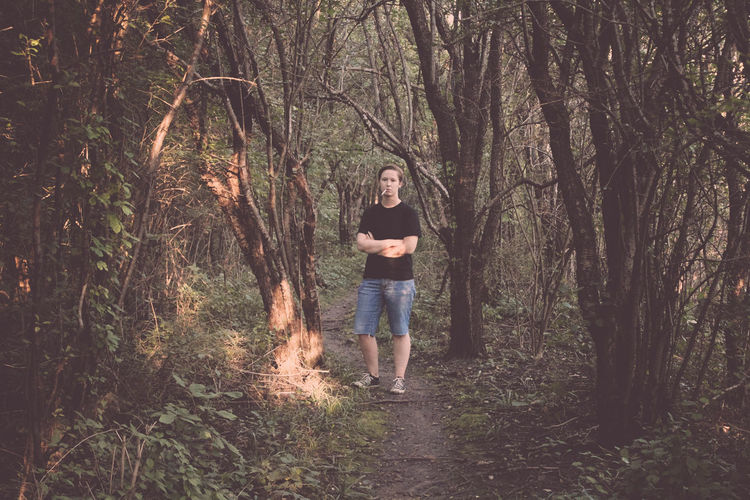 Beauty In Nature Casual Clothing Cigarette Smoking Day Footpath Forest Full Length Growth Leisure Activity Lifestyles Nature Non-urban Scene Outdoors Plant Portrait Smoking The Way Forward Tough Natural Light Portrait Tranquility Tree Tree Trunk WoodLand Uniqueness