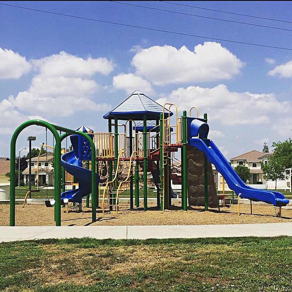 The world is a playground. You know that when you're a kid, but somewhere along the way we forget it Playground Colors Neighborhood Fun Swingset Slide Childhood Memories Nature Blueskies White Clouds TheValley