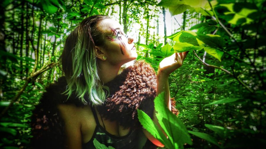 The Portraitist - 2017 EyeEm Awards One Person Tree Green Color Nature Real People Leaf Plant Outdoors Young Women Wild Long Hair Young Adult The Portraitist - 2017 EyeEm Awards