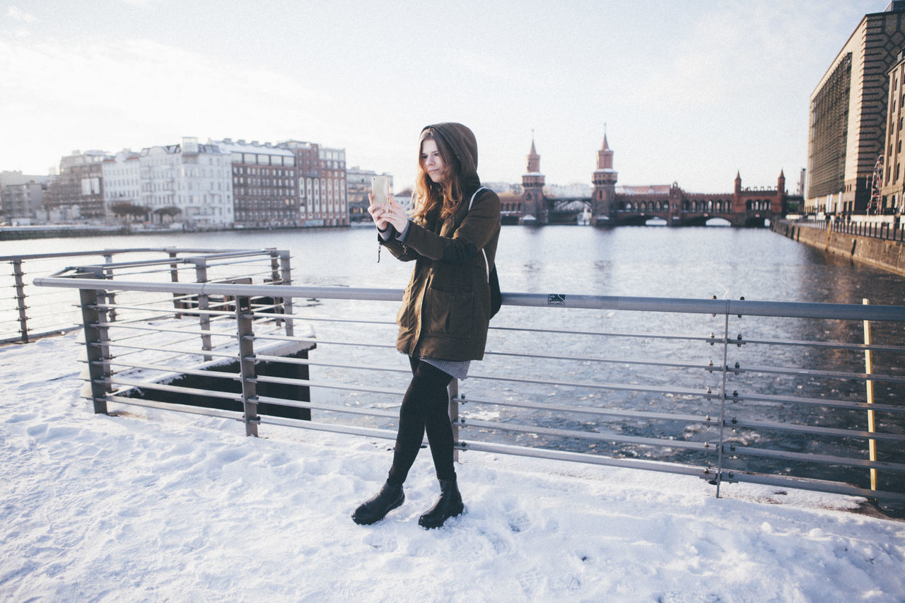 Woman Taking A Photograph With A Smart Phone