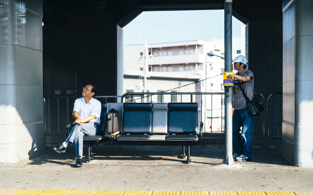 Waiting in Kyoto, Japan. Adult Adults Only Architecture Bench Businessman Commute Contrast Day Framed Full Length Japan Mature Adult Mature Men Men Outdoors People Platform Seats Sunny Train Station Waiting Working