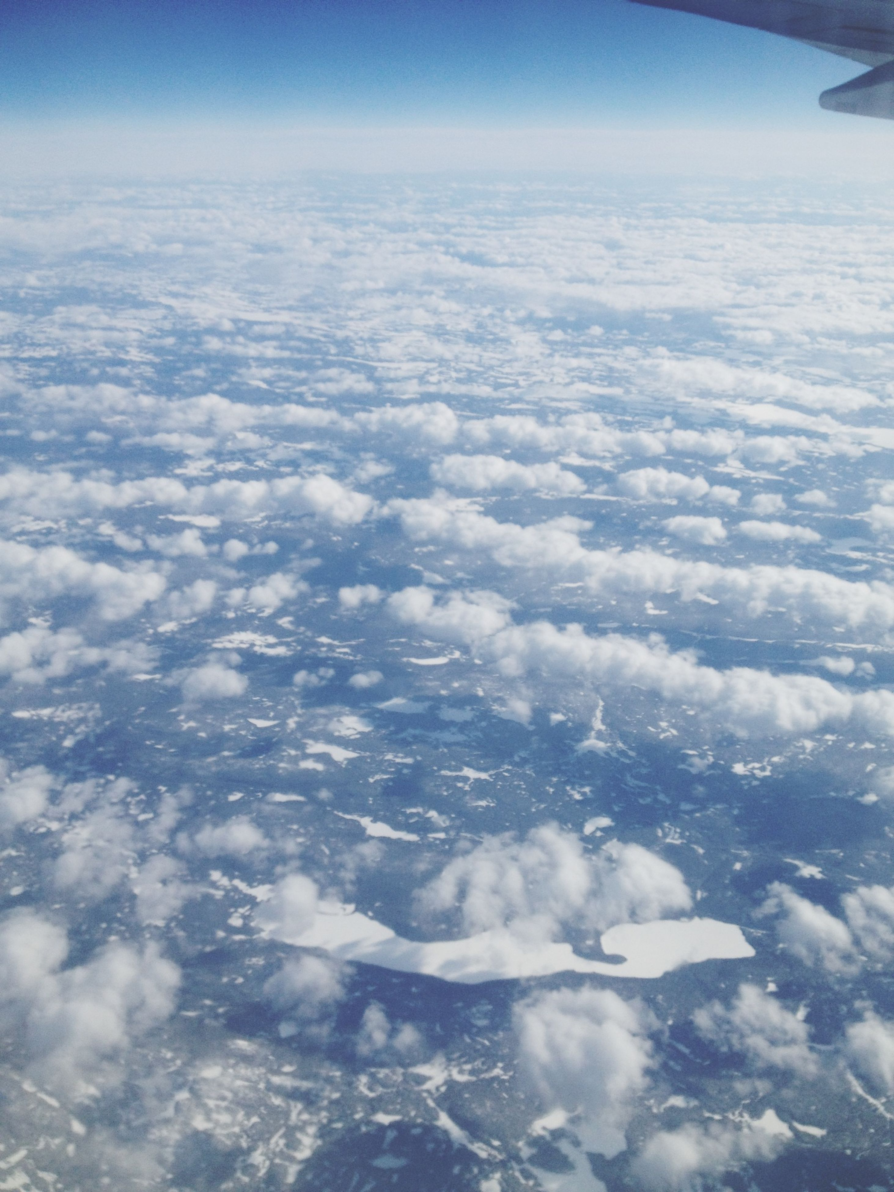 aerial view, scenics, snow, beauty in nature, tranquil scene, landscape, winter, tranquility, cold temperature, nature, sky, blue, mountain, white color, idyllic, cloud - sky, season, weather, majestic, cloud