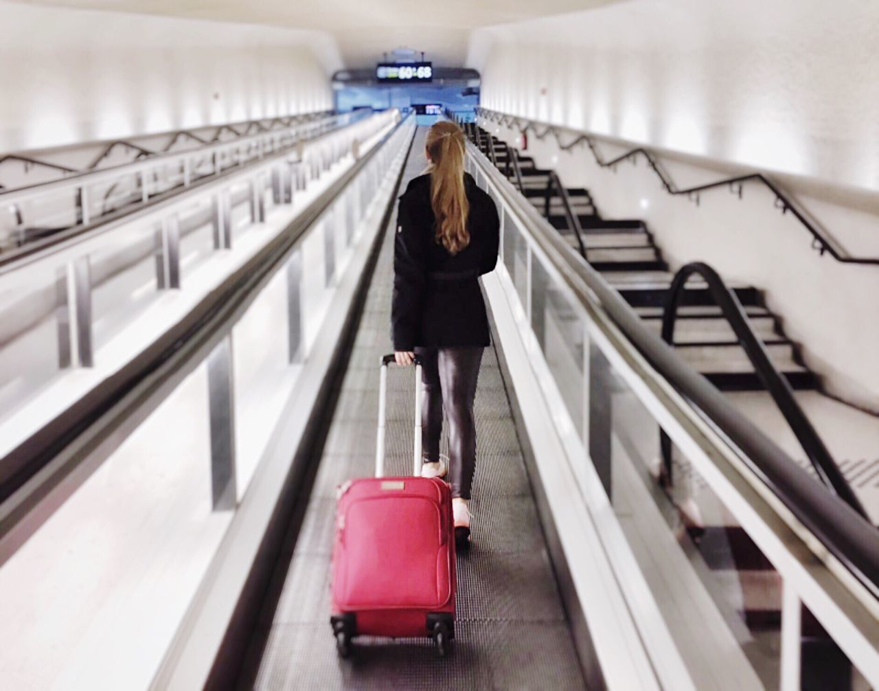 On my way - On My Way Airport Runway Airportphotography Airport On My Way To Work Airport Terminal Airportlife Red Suitcases  Suitcase Runway Flughafen Travelling Travel Young Adult Pony Tail  Abstract Perspectives From The Back Geometric Shapes Futuristic Architecture Futuristic Symmetry Full Frame Capture The Moment