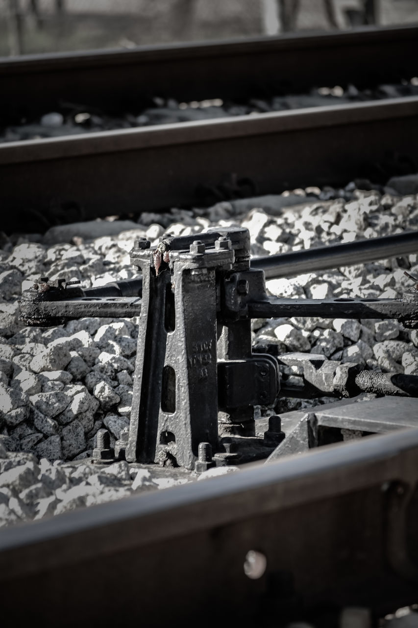 railroad track, rail transportation, no people, metal, train - vehicle, machinery, industry, technology, close-up, day, manufacturing equipment, outdoors