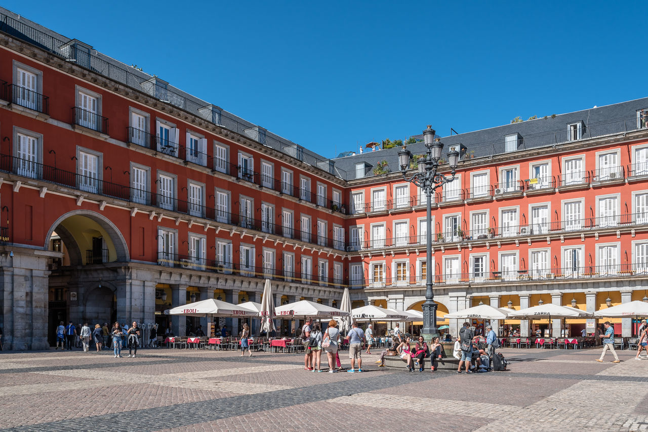 Plaza mayor of Madrid a sunny day of summer Architecture Madrid Place SPAIN Square Tourist Attraction  Tourists Travel Architecture Building Exterior Built Structure Capital Cities  City Historical Landmark Large Group Of People Old Outdoors Plaza Mayor Real People Tourism Tourism Destination Tourist Destination Town Square Travel Destinations