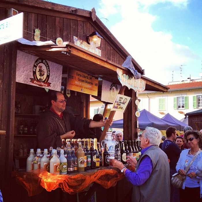"""""""i frati birraioli"""" - beer brewing friars selling their beers at food fair in Lazzate, northern Italy"""