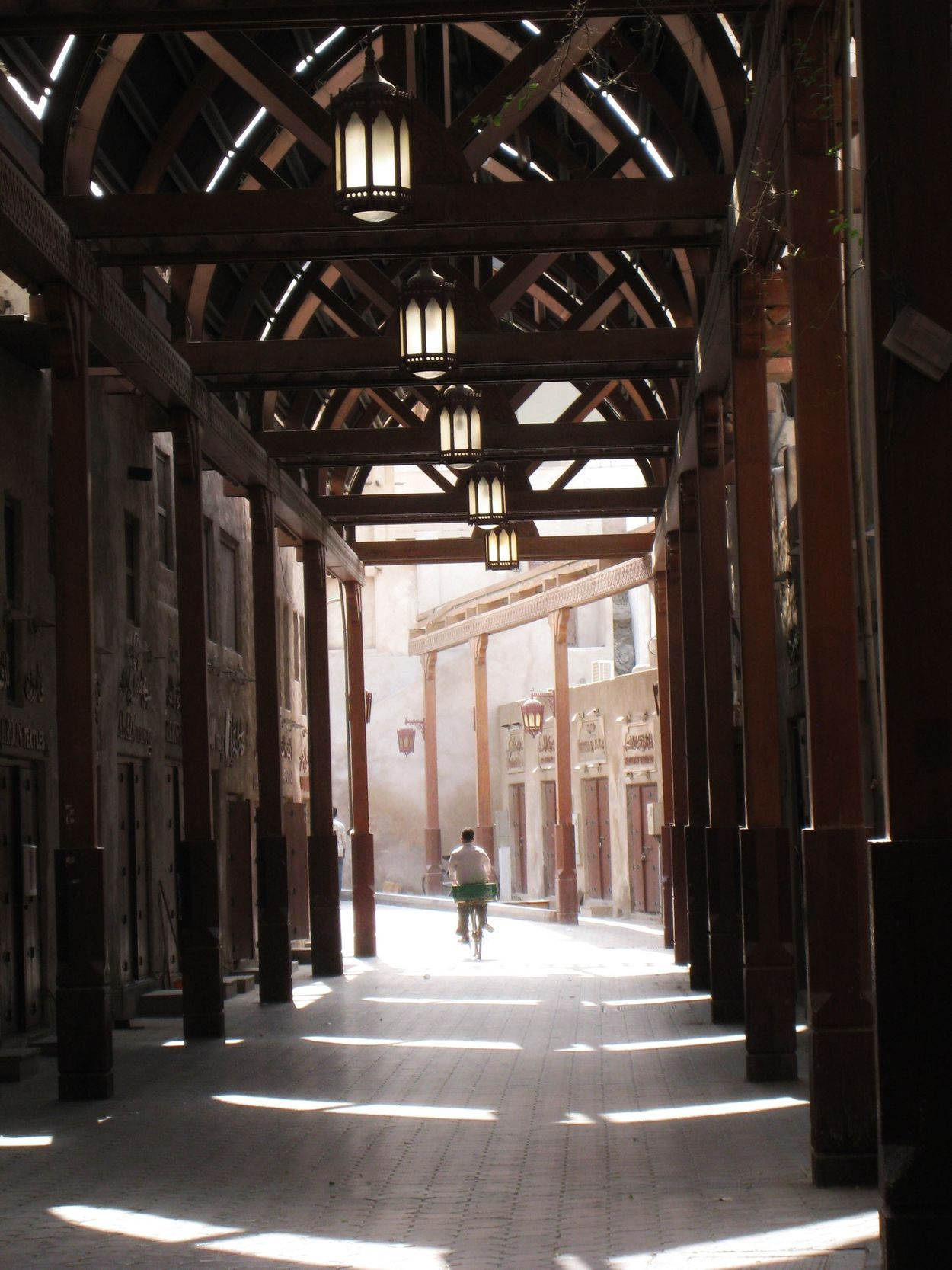 Most have escaped the midday heat, this lone cyclist is the only activity in the Old Souq... Dubai Traveling Urban Geometry Travel