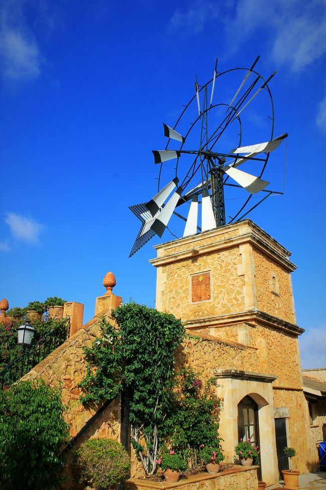 Windmill Building Exterior Architecture Naturelovers Travel Destinations Silhouette Blue Sky Ladyphotographerofthemonth Still Life Travel Idyllic Moments Holyday Mallorca Landscape Mill Windmill Garden Finca Environmental Conservation Built Structure Wind Power Outdoors No People Sky
