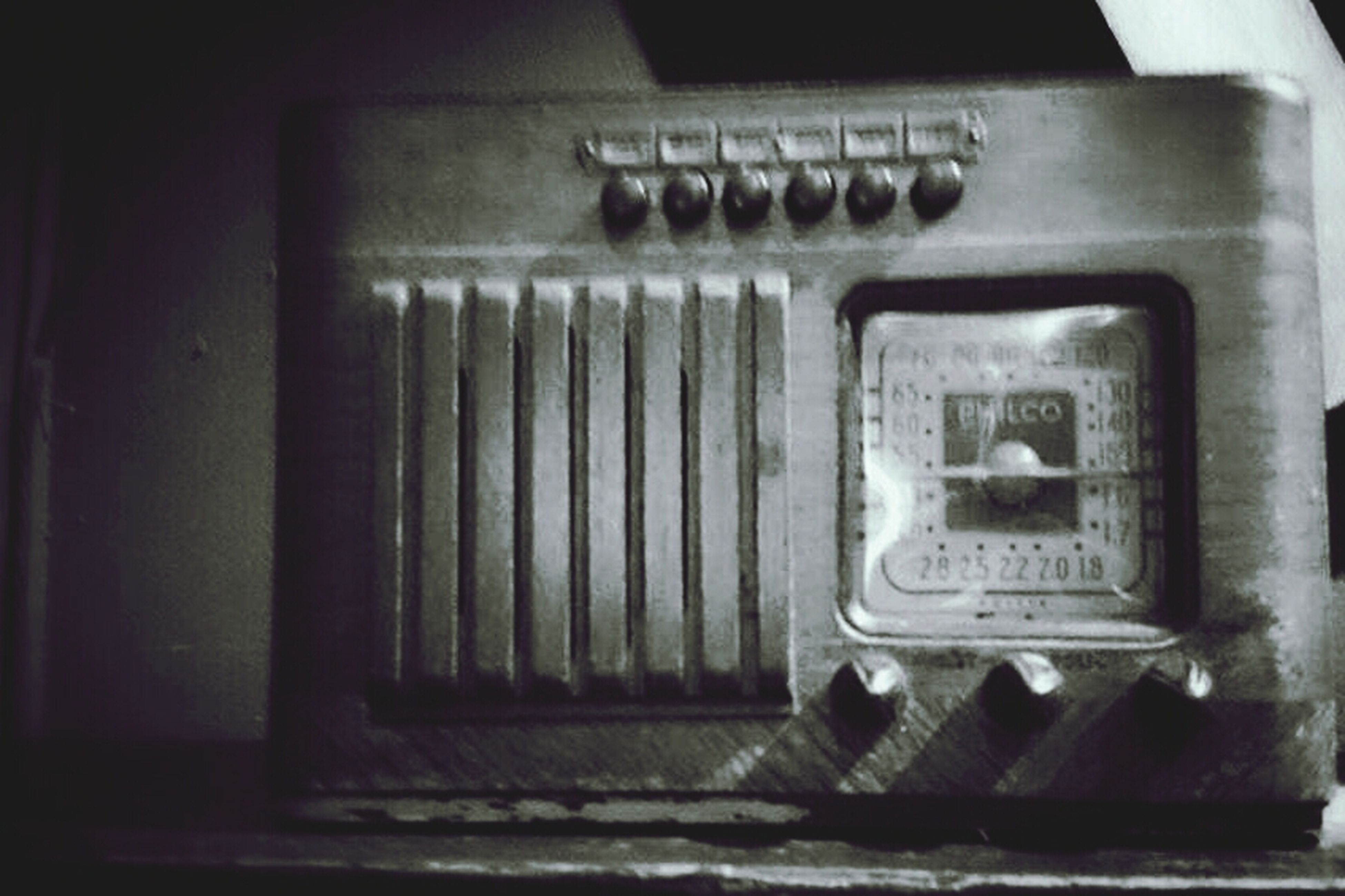 indoors, communication, old, old-fashioned, technology, metal, close-up, text, retro styled, door, number, wall - building feature, telephone, western script, connection, no people, metallic, obsolete, electricity, closed