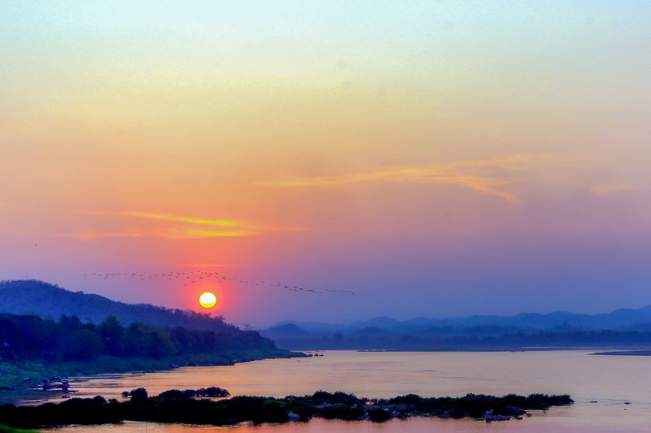 sunset at Chaing Khan Beauty In Nature Makhong River Mountain Nature Orange Color Outdoors River View Scenics Silhouette Sky Sun Sunrise_Collection Sunset Tranquil Scene Tranquility Twilight Sky Water
