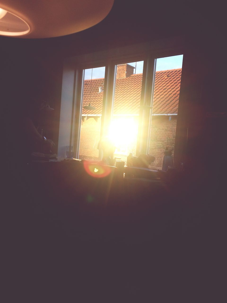 lens flare, sun, sunlight, window, sunbeam, sunset, indoors, silhouette, built structure, real people, illuminated, architecture, day, sky