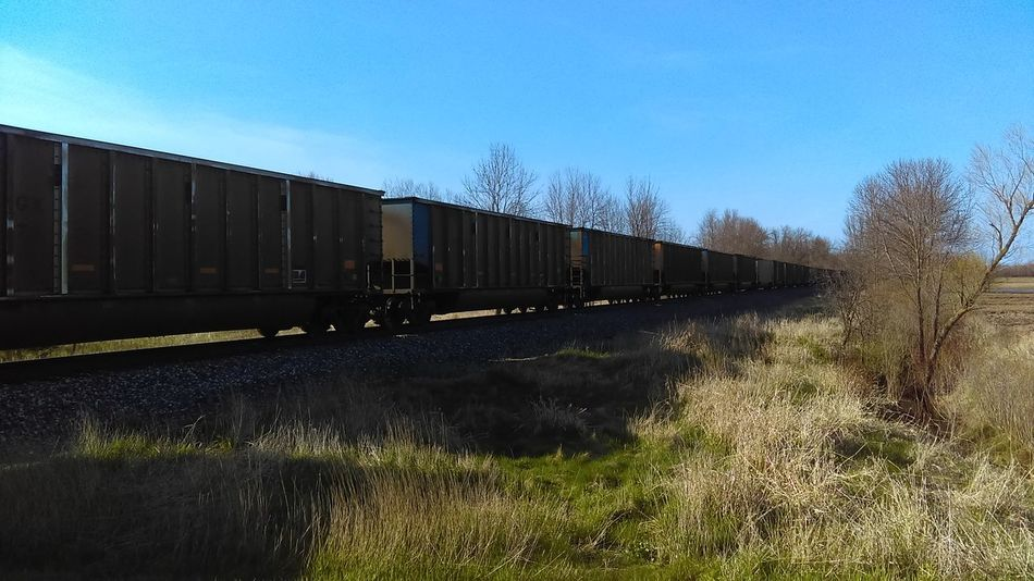 Train - Vehicle Freight Transportation Rail Transportation Railroad Track Freight Train Transportation Mode Of Transport Sky Cargo Container Outdoors No People Day Clear Sky Grass Nature Locomotive