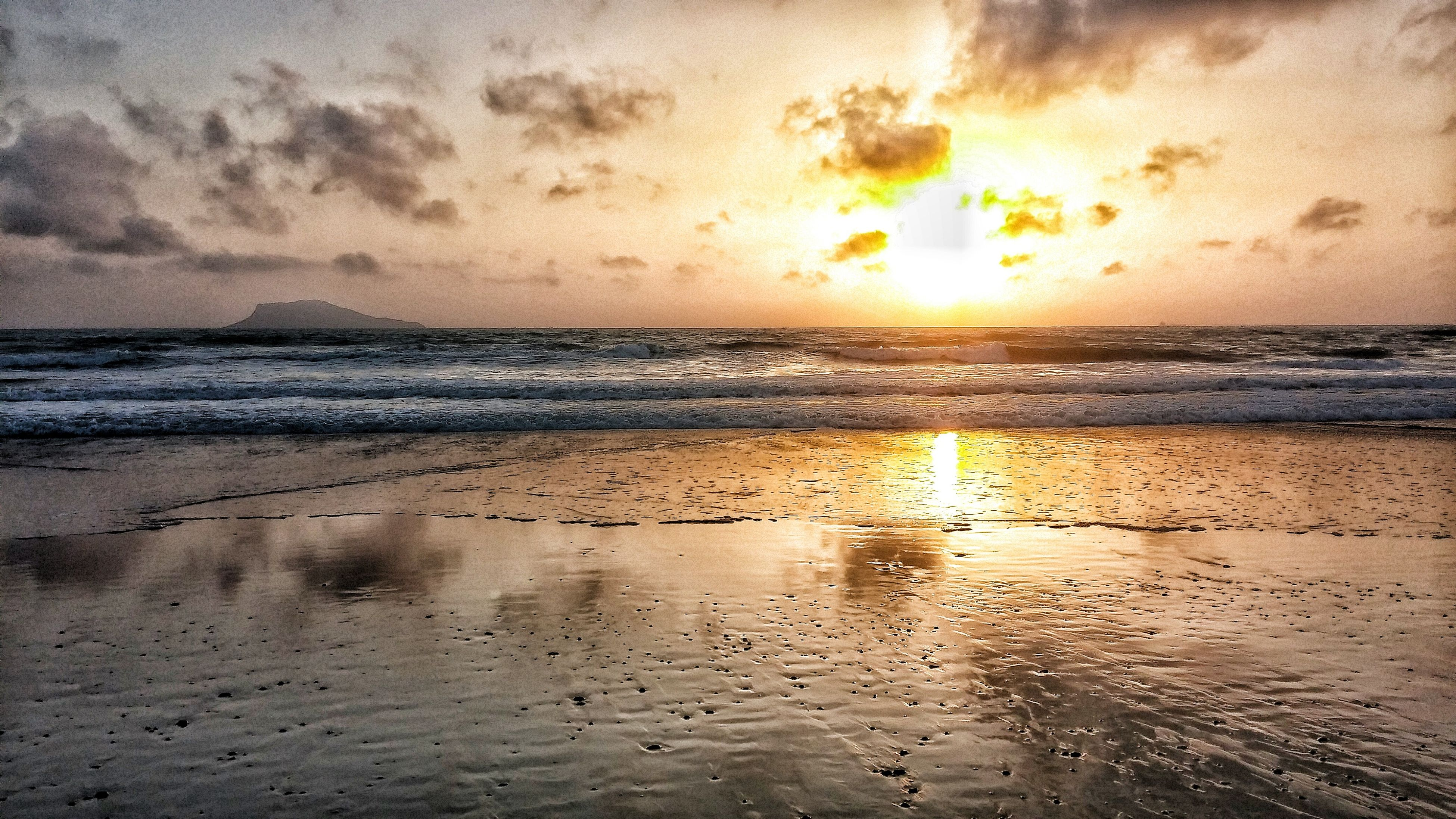 sunset, sea, beach, water, scenics, tranquil scene, beauty in nature, horizon over water, tranquility, shore, idyllic, sky, sun, reflection, nature, cloud - sky, wave, majestic, orange color, vacations, seascape, non-urban scene, calm, outdoors, summer, vibrant color, remote, tourism, tide, no people