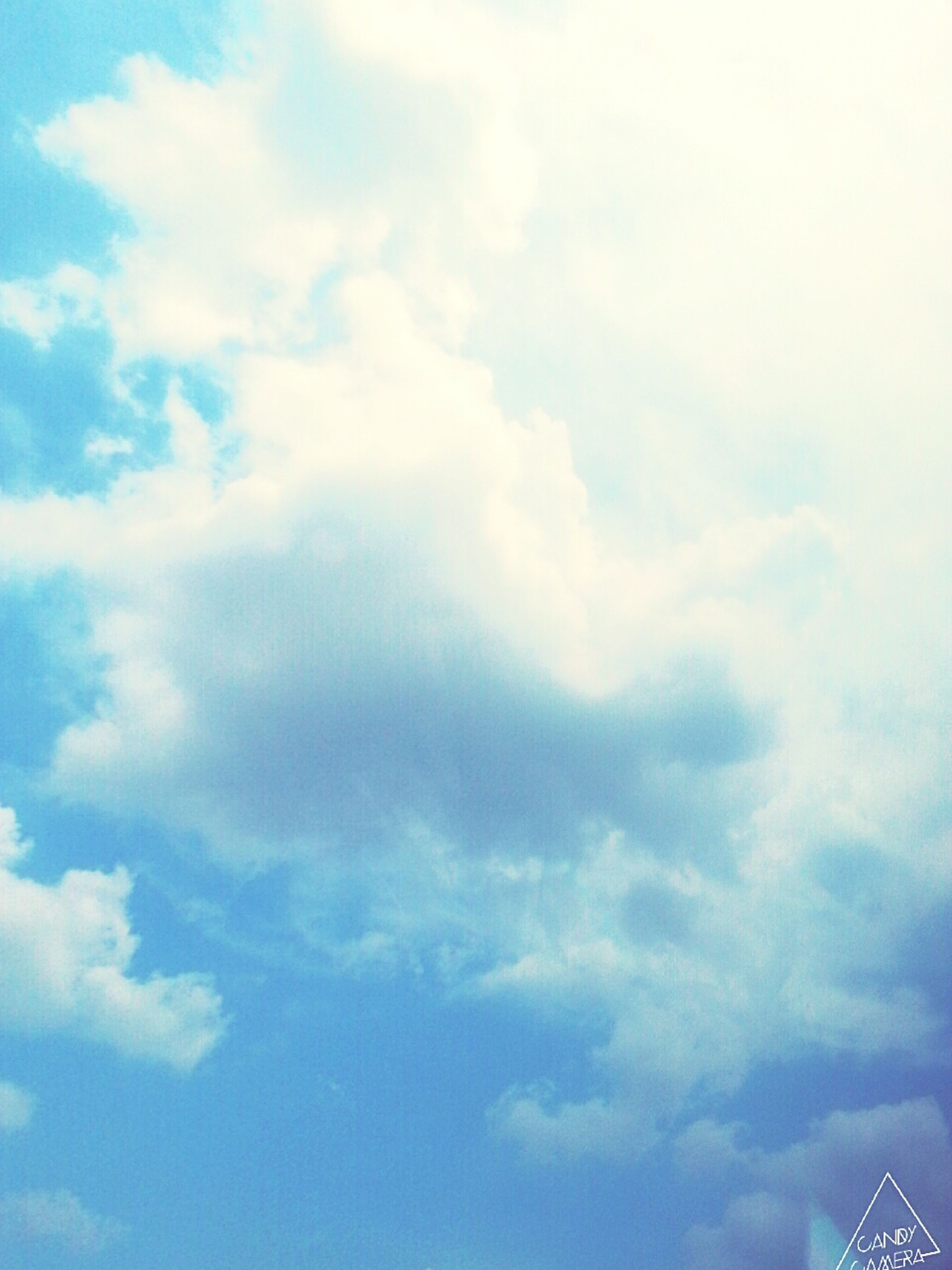 low angle view, sky, cloud - sky, cloudy, beauty in nature, blue, nature, cloud, sky only, backgrounds, tranquility, scenics, day, cloudscape, outdoors, full frame, no people, white color, high section, tranquil scene