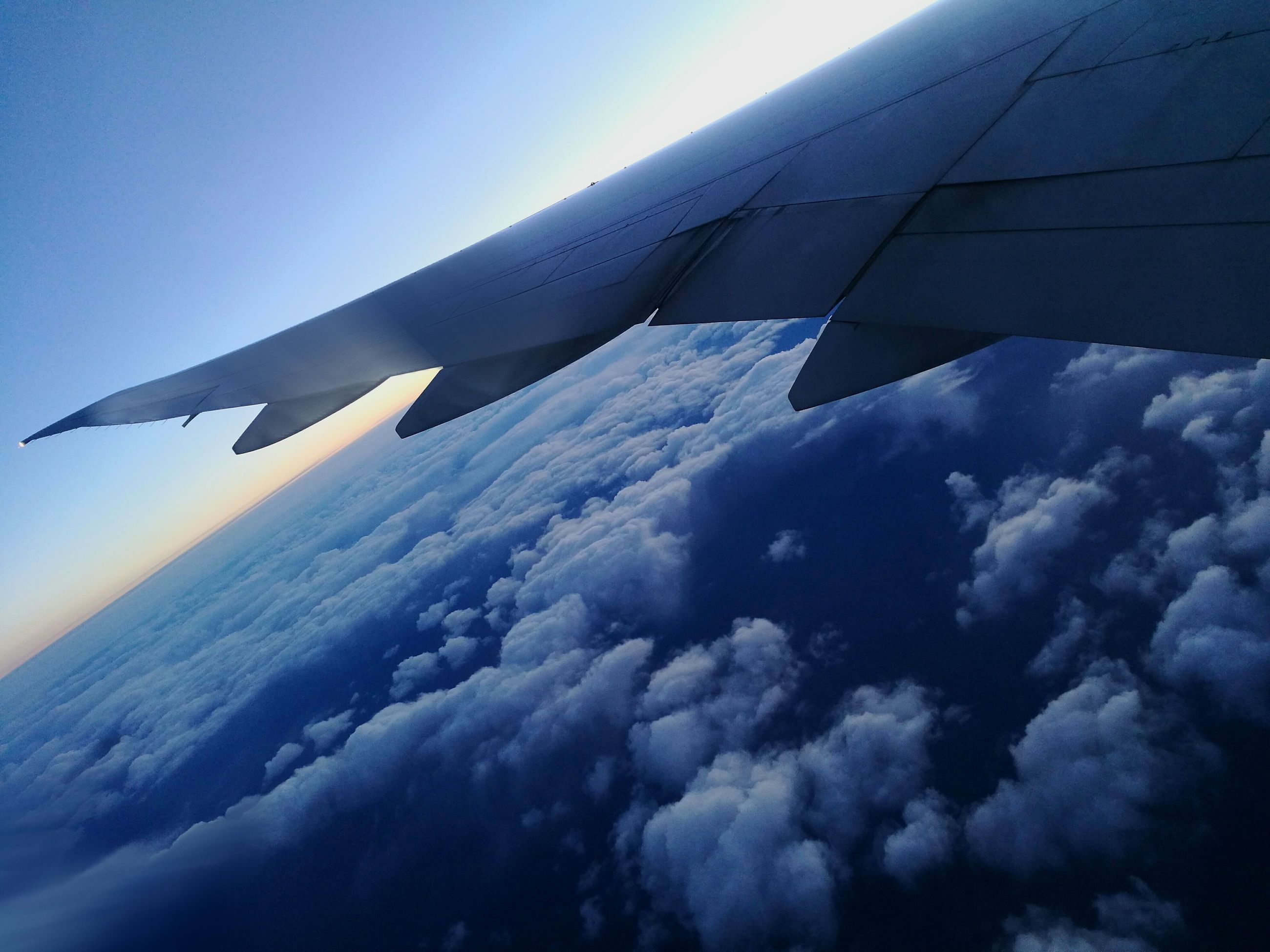 sky, cloud - sky, blue, airplane, transportation, no people, outdoors, nature, day, low angle view, flying, beauty in nature, airplane wing