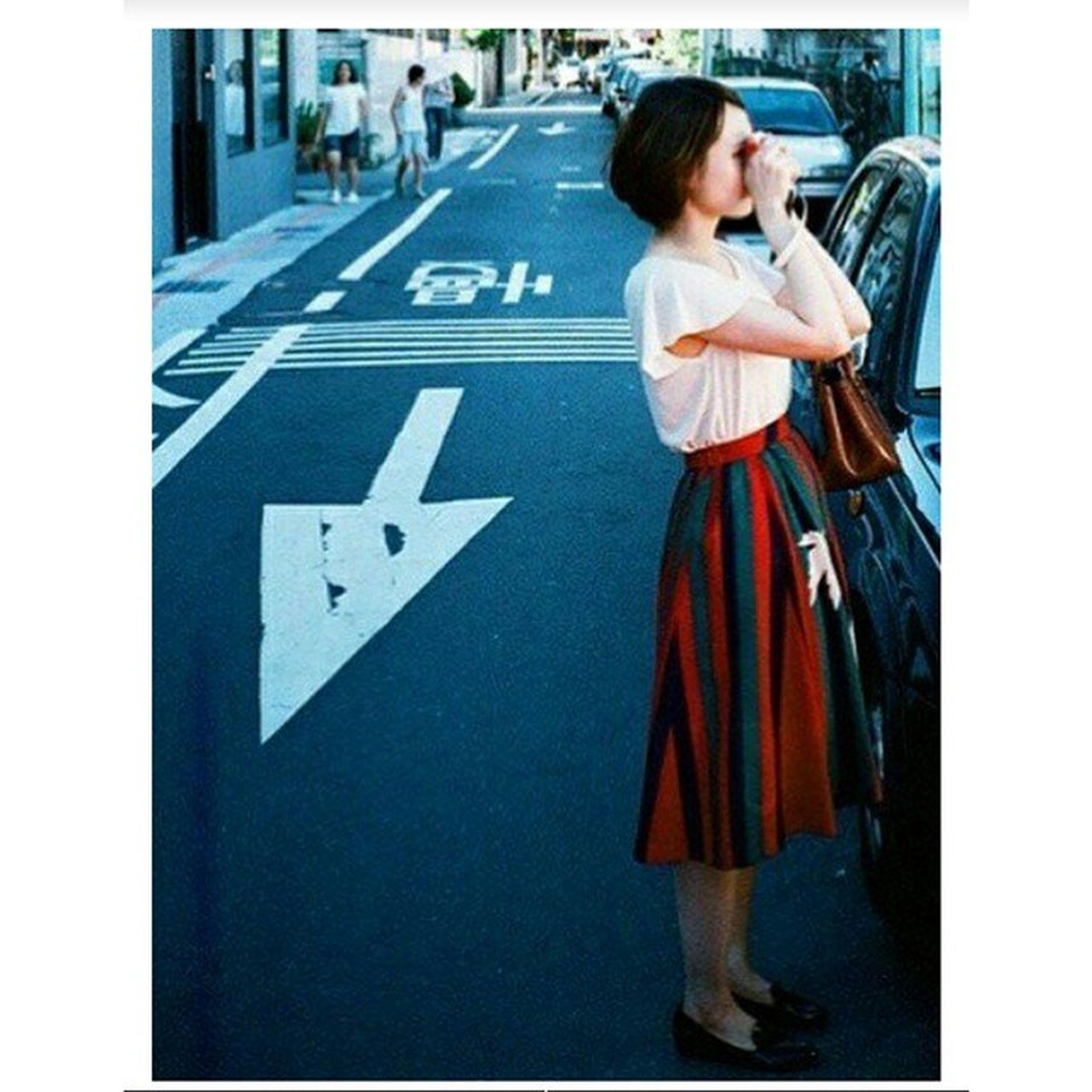 transfer print, communication, auto post production filter, street, lifestyles, full length, casual clothing, text, city, leisure activity, road, transportation, person, western script, front view, men, road marking, holding