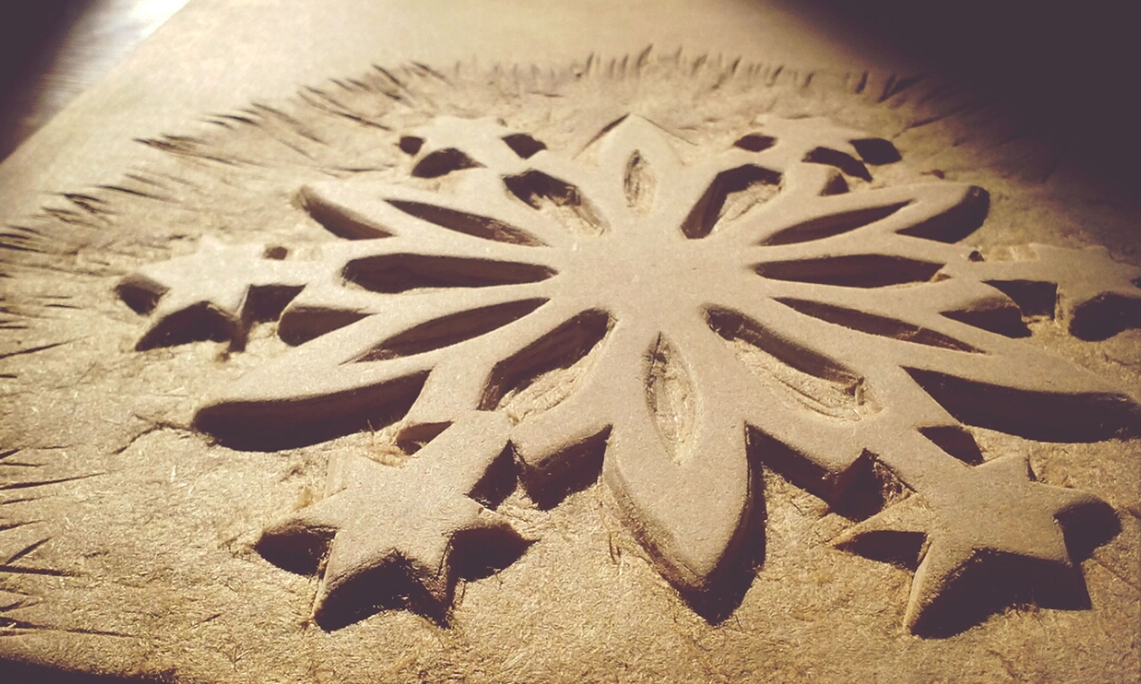 art and craft, close-up, art, creativity, pattern, no people, indoors, still life, craft, design, animal representation, shape, high angle view, star shape, day, sand, carving - craft product, textured, sunlight