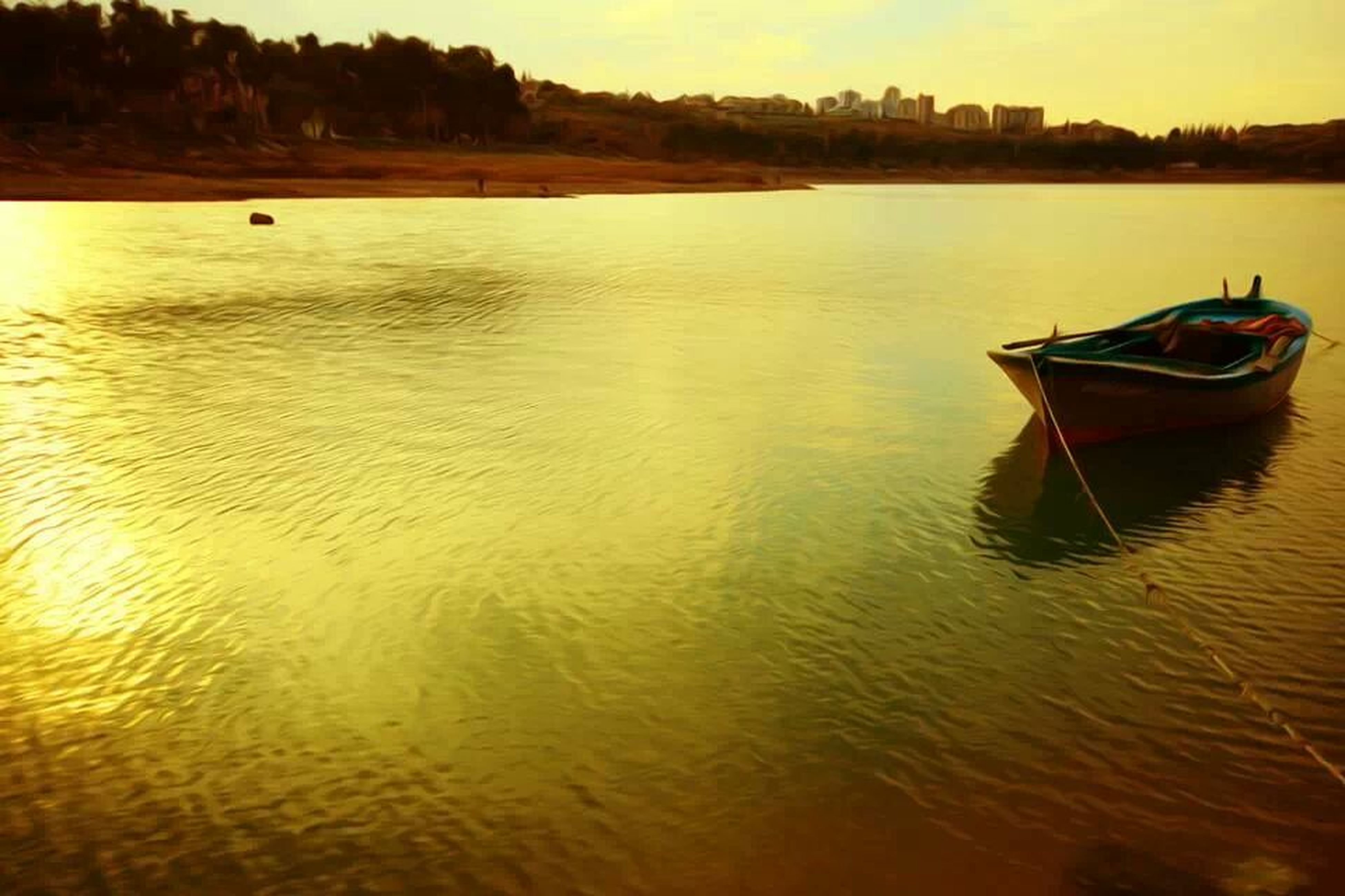 water, nautical vessel, boat, transportation, mode of transport, sunset, waterfront, moored, reflection, rippled, lake, tranquil scene, tranquility, river, nature, scenics, sea, orange color, beauty in nature, outdoors
