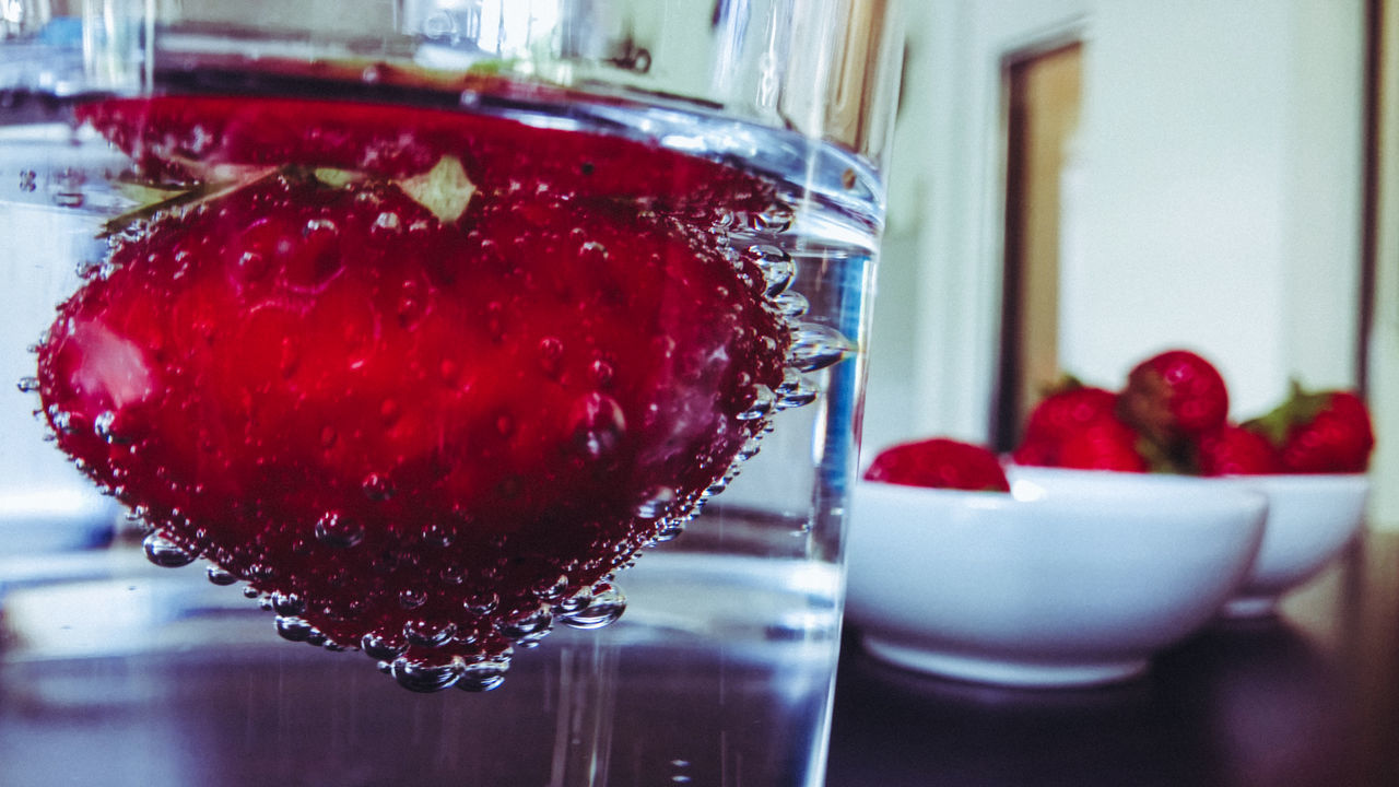 Close-up Day Desk Drink Drinking Glass Drinking Water Focus On Foreground Food Food And Drink Freshness Fruit Healthy Eating Indoors  No People Office Ready-to-eat Red Reflection Refreshment Strawberry Sweet Food Table Water Water Glass