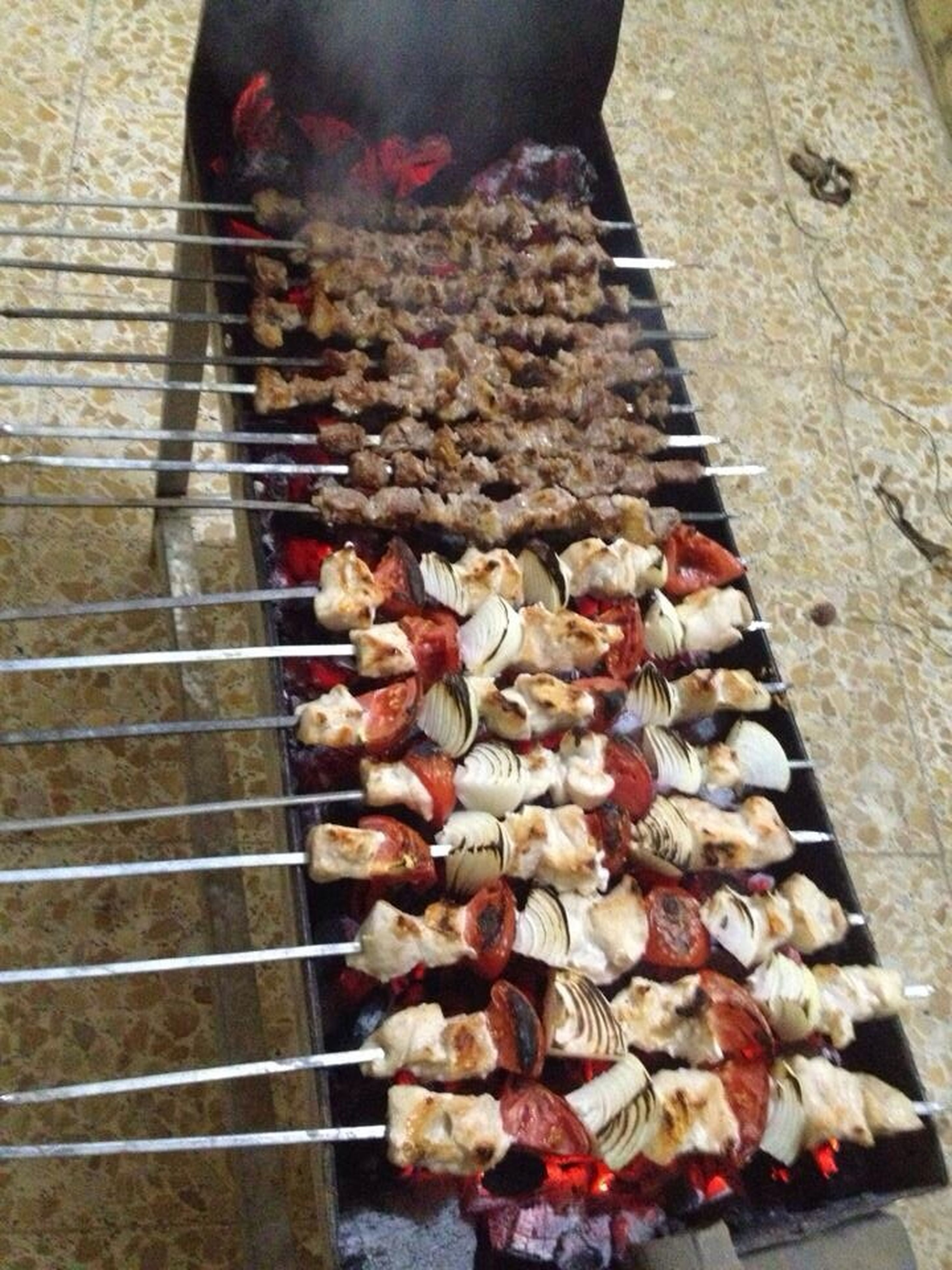 food and drink, food, freshness, large group of objects, healthy eating, abundance, high angle view, barbecue grill, for sale, retail, market stall, preparation, market, indoors, meat, variation, preparing food, still life
