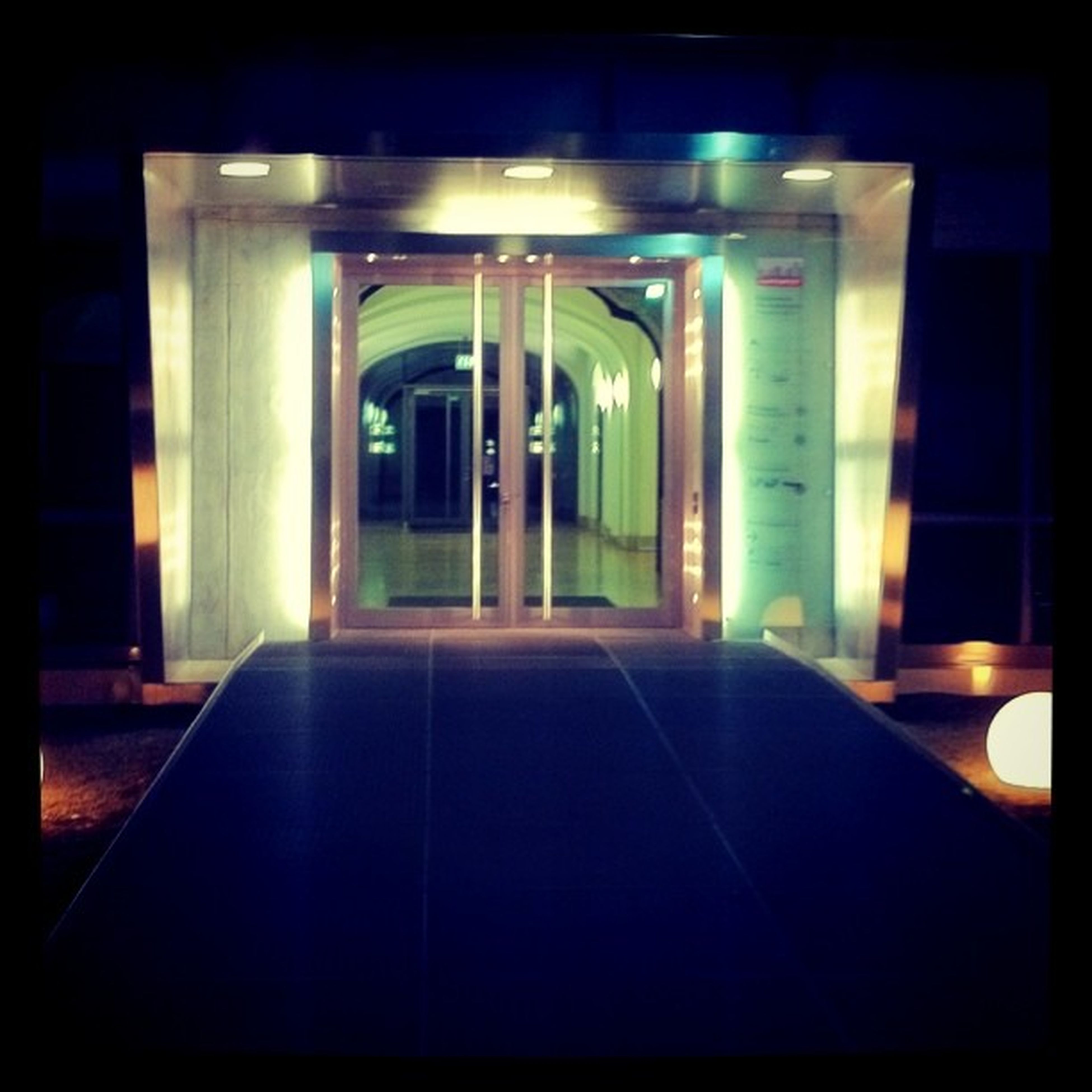 architecture, indoors, built structure, illuminated, empty, window, the way forward, absence, door, no people, building exterior, arch, building, architectural column, interior, dark, diminishing perspective, transportation, corridor, entrance