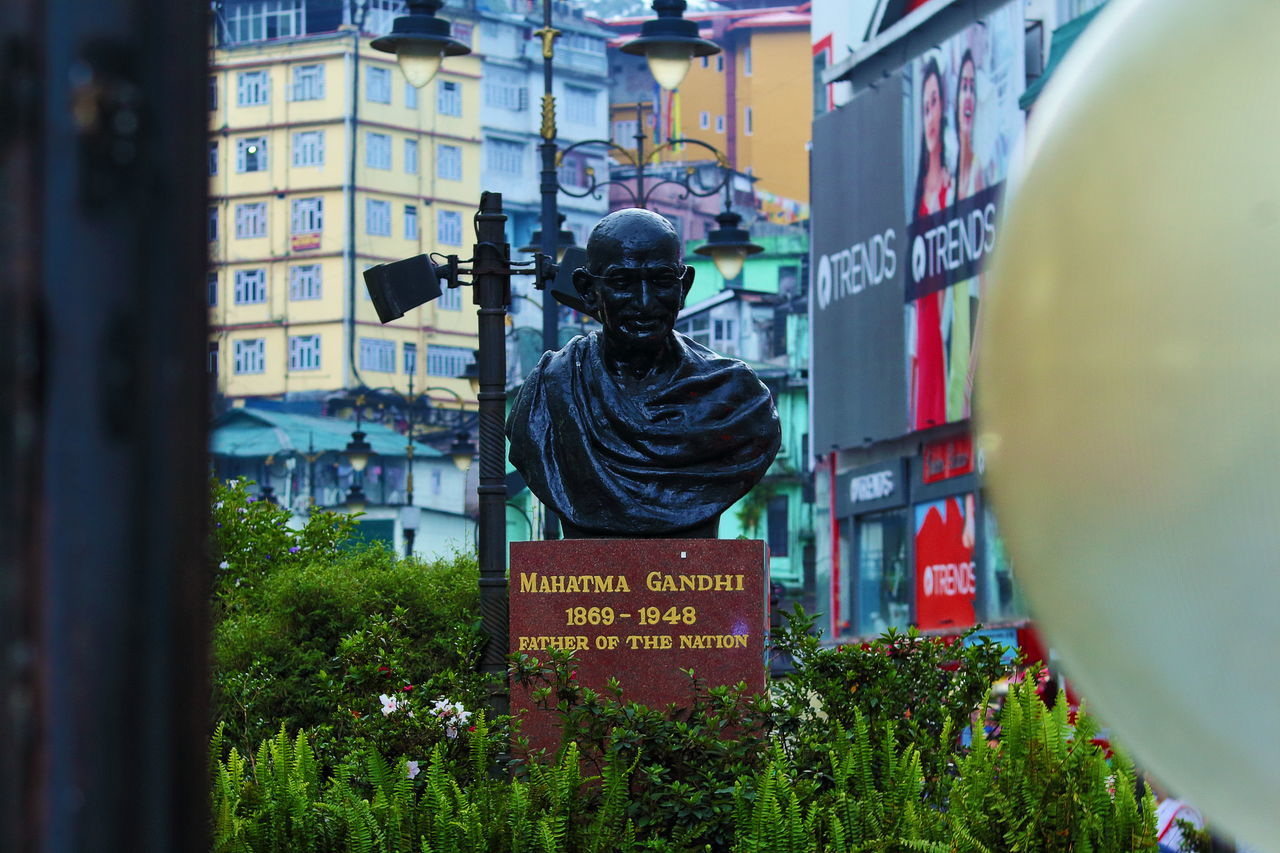 Still standing, still guiding Gandhi Statue Architecture Outdoors Built Structure Day Building Exterior City Sculpture No People Sikkimdiaries EyeEmNewHere Mg Marg Mg Road Gangtok Gangtok, India Tourism Street Photography Neighborhood Map Sikkim,india