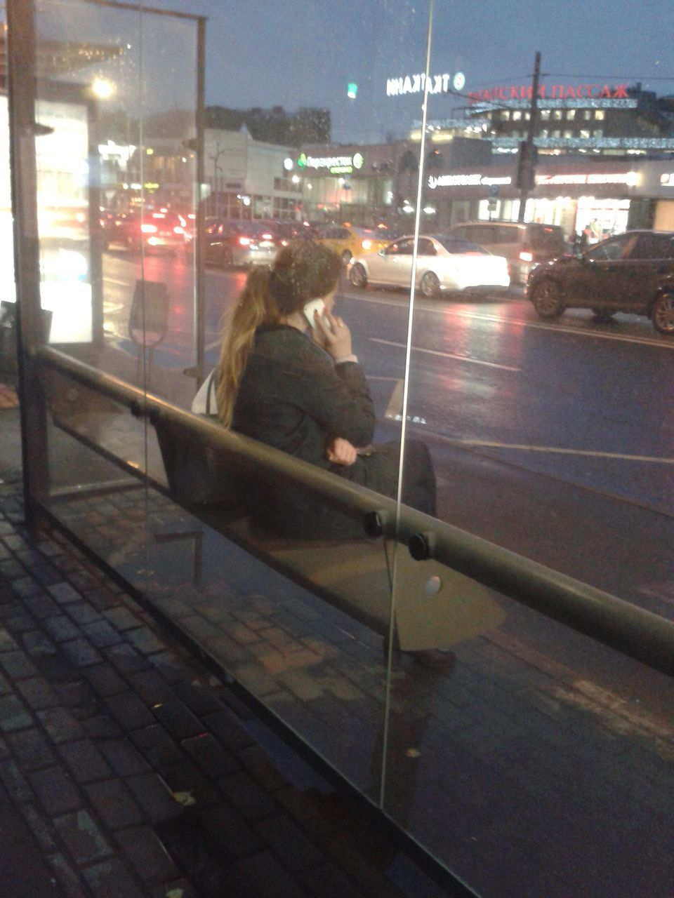 one person, real people, illuminated, sitting, night, women, outdoors, city, architecture, young adult, sky, people