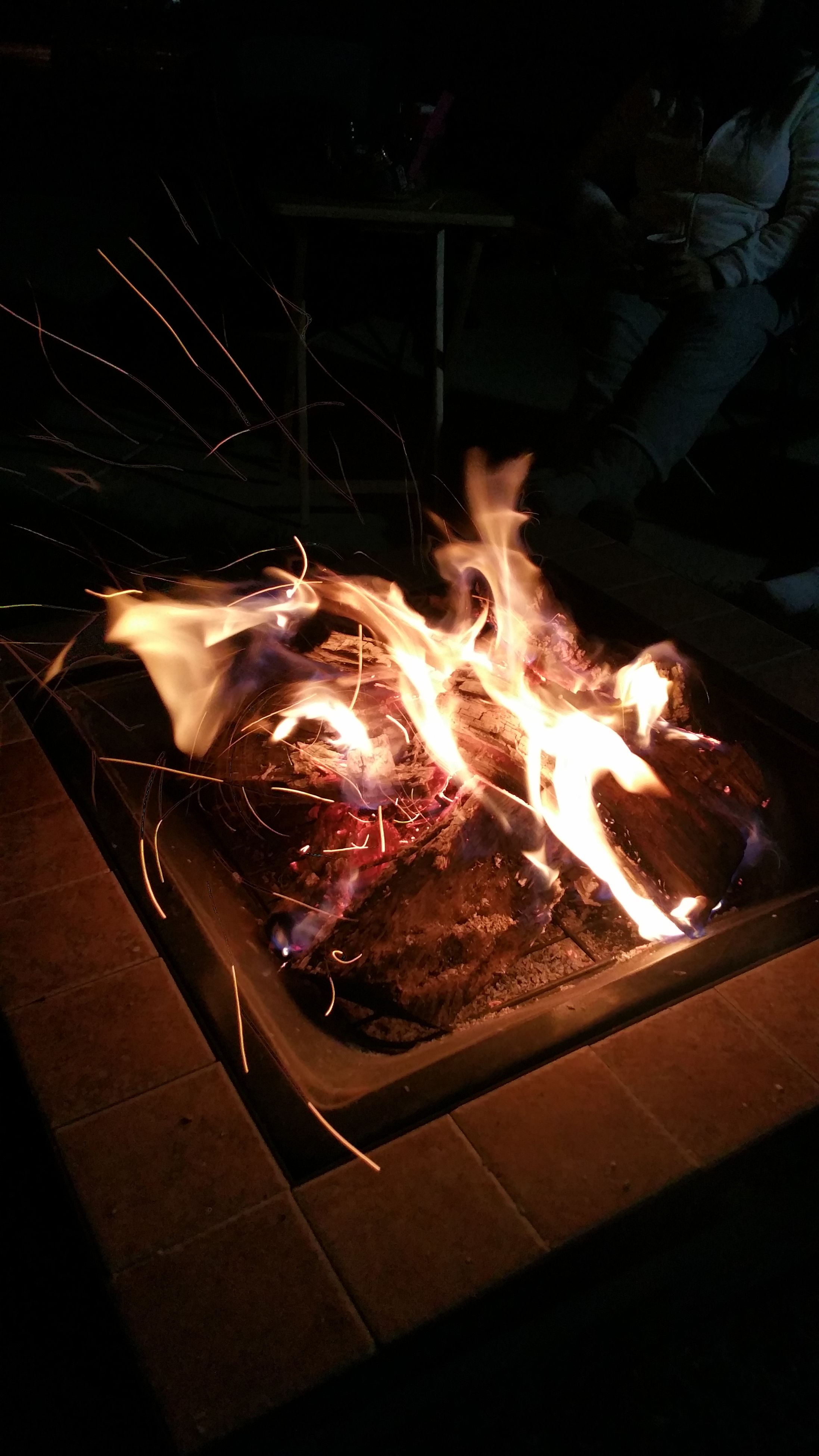 night, burning, fire - natural phenomenon, flame, indoors, heat - temperature, illuminated, lifestyles, standing, leisure activity, glowing, dark, light - natural phenomenon, bonfire, fire, sitting, men, person
