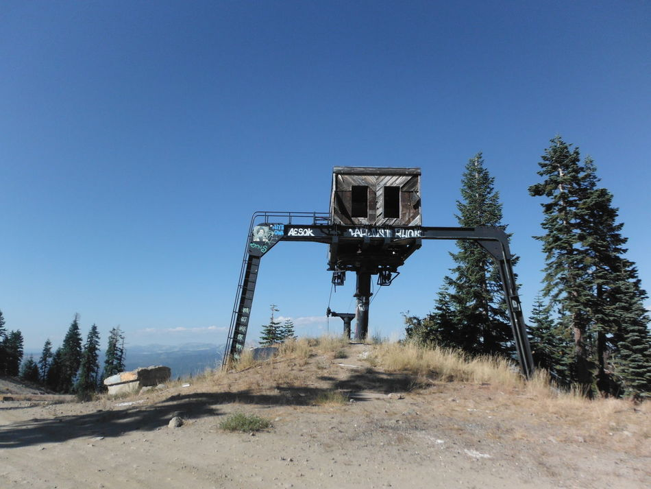 Abandoned Abandoned Places Blue Sky Clear Sky Contrast Creepy Day Derelict Eerie Lake Tahoe Low Angle View Nature No People Outdoors Ski Lift Ski Resort  Ski Run Skiing Sky Sunny Tree