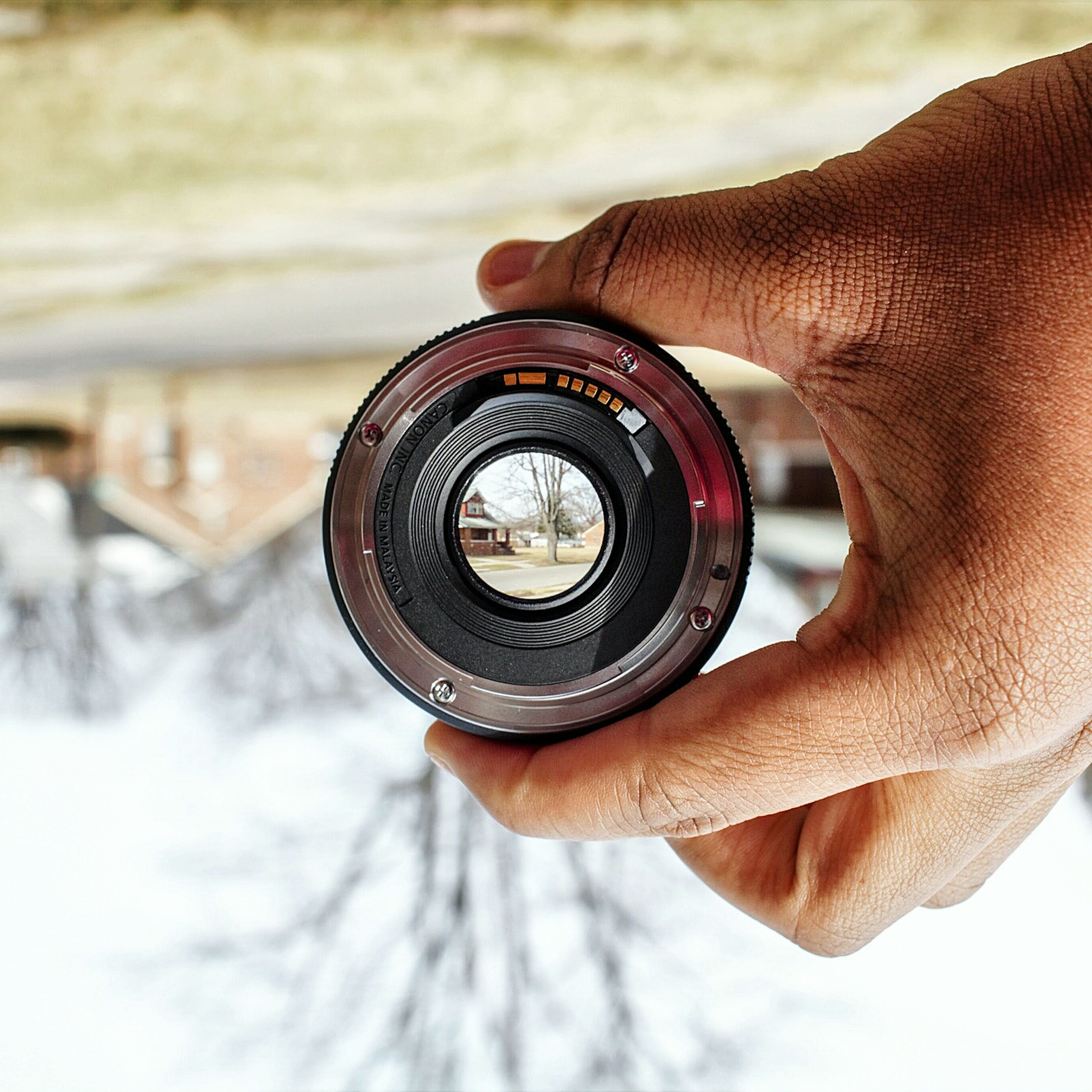 close-up, part of, focus on foreground, person, cropped, spiral, circle, photography themes, metal, day, single object, holding, outdoors, selective focus, sunglasses, unrecognizable person, technology