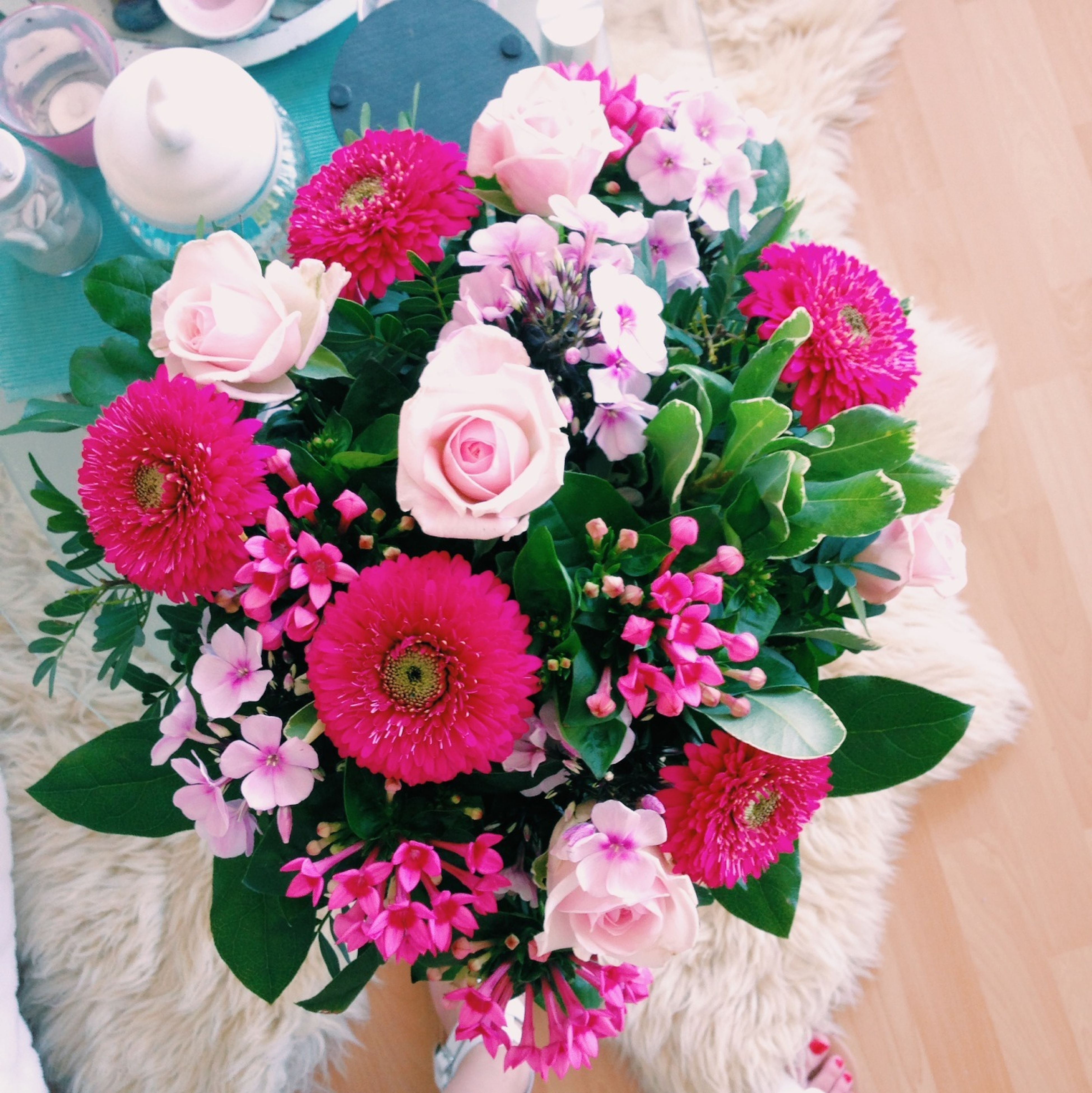 flower, indoors, freshness, fragility, petal, vase, high angle view, bouquet, table, flower head, flower arrangement, bunch of flowers, pink color, rose - flower, decoration, home interior, beauty in nature, multi colored, directly above, plant