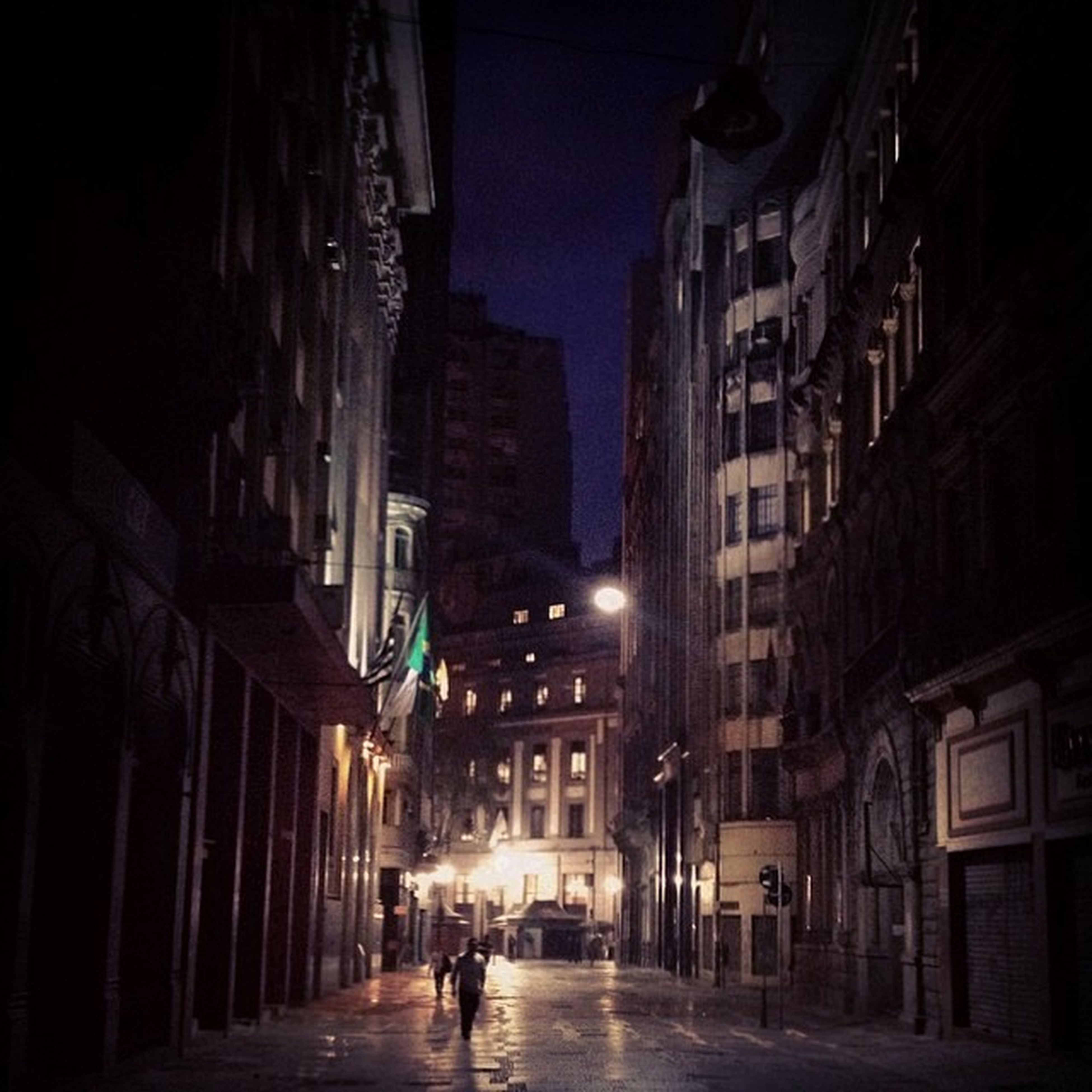 building exterior, architecture, built structure, street, night, city, illuminated, the way forward, street light, city life, road, residential structure, residential building, building, city street, car, transportation, diminishing perspective, incidental people, alley