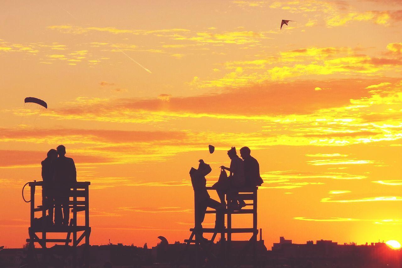 Beautiful stock photos of sunset, Berlin, Cloud - Sky, Five People, Flying